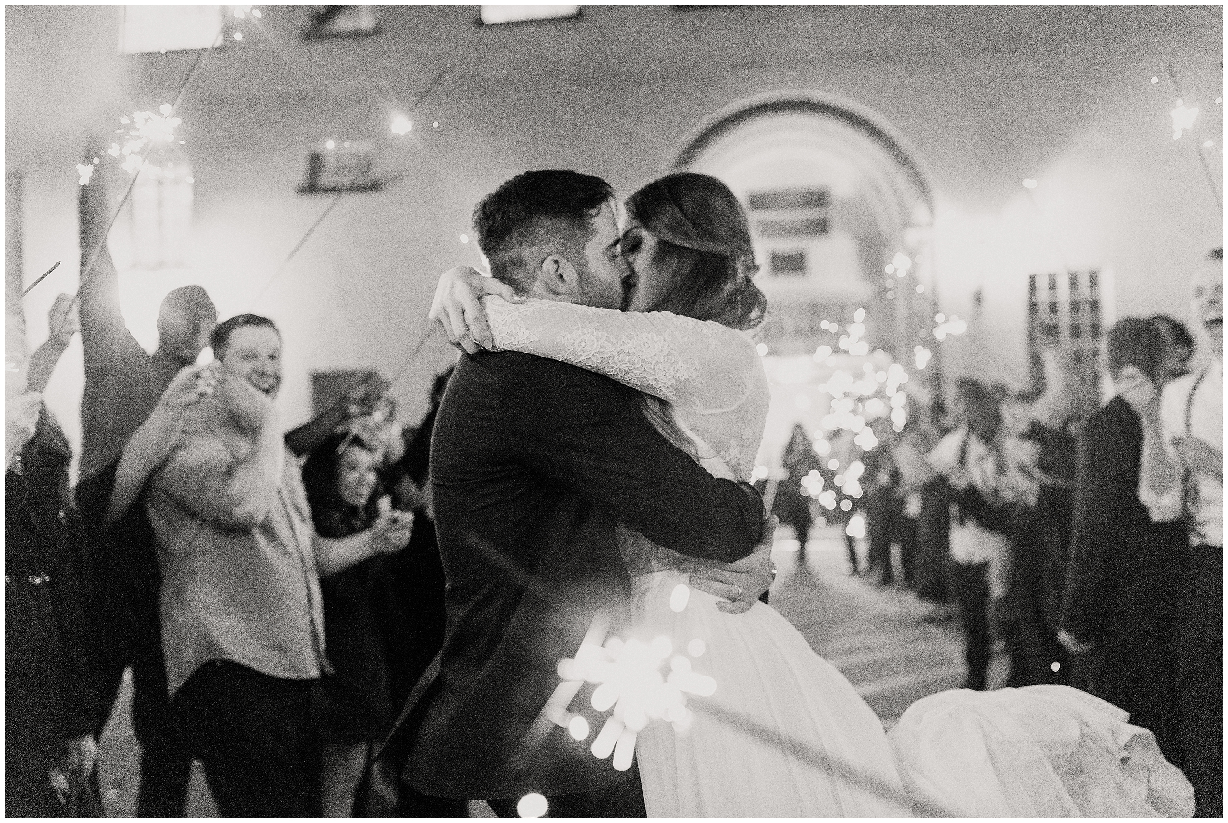 oklahoma wedding photographer reception family friends hugs congratulations best wishes toasts going away sparklers party