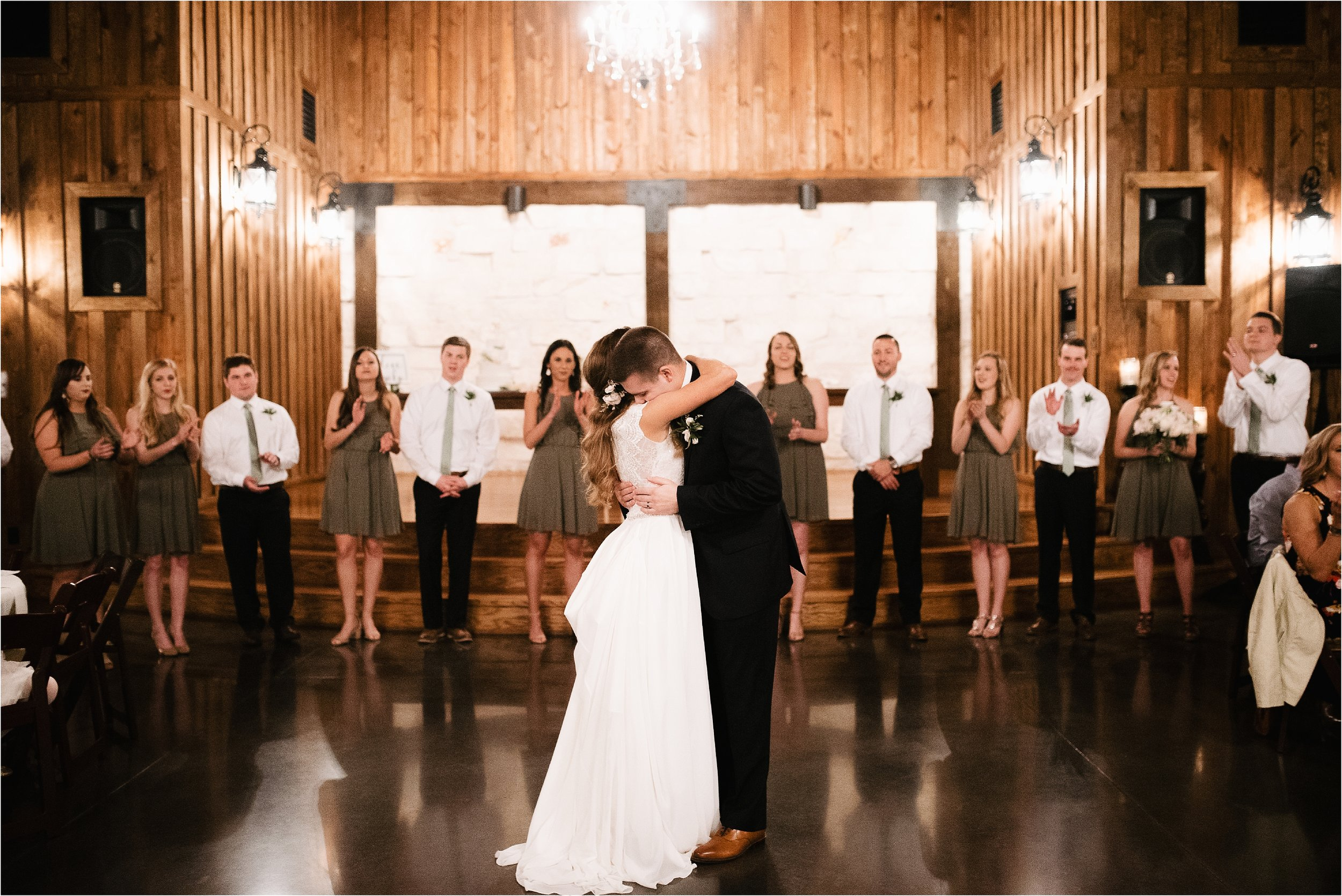 oklahoma wedding photographer reception family friends hugs congratulations best wishes toasts