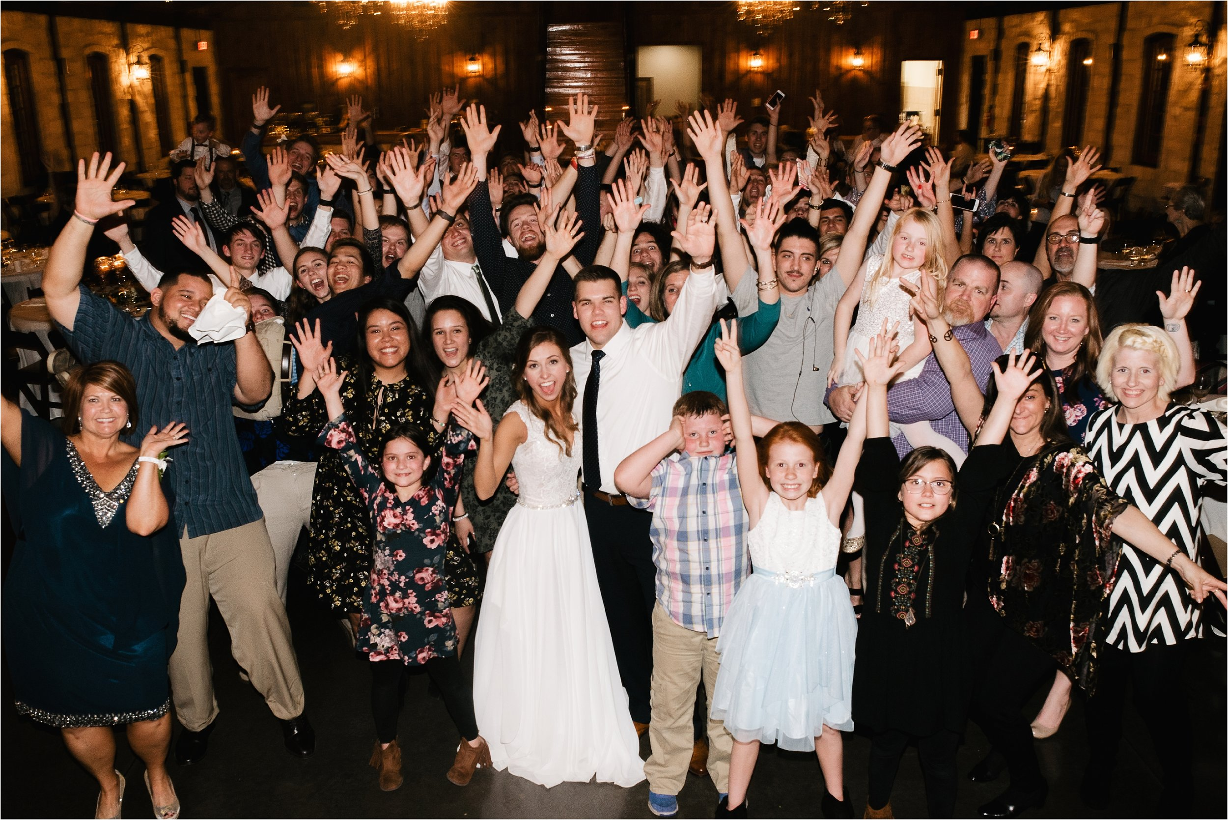 oklahoma wedding photographer reception family friends hugs congratulations best wishes toasts dancing the springs norman okc group photograph