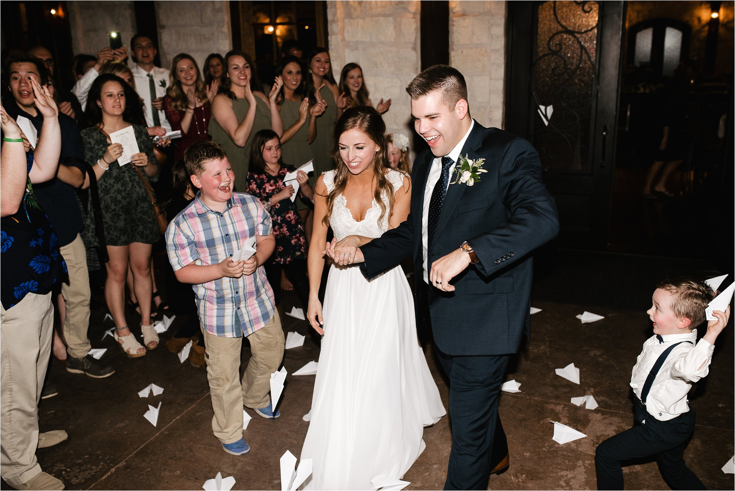 oklahoma wedding photographer reception family friends hugs congratulations best wishes exit paper planes the springs norman okc