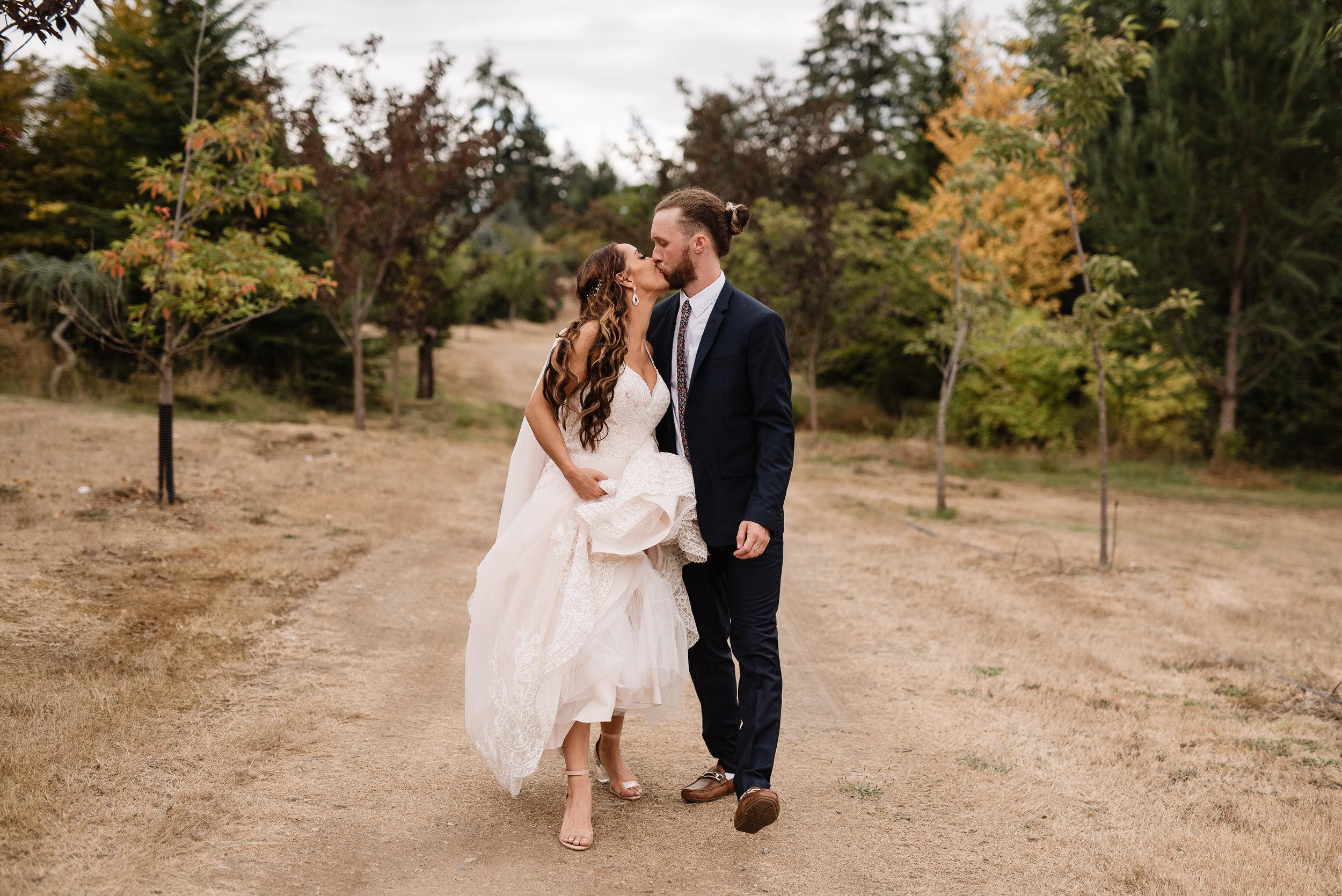oklahoma wedding photographer bride groom wedding day outside seattle overcast walking wedding portrait lifestyle