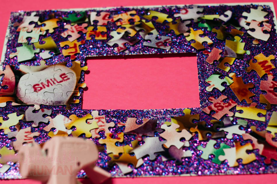 Hot Glue all the pieces to the photoboard.