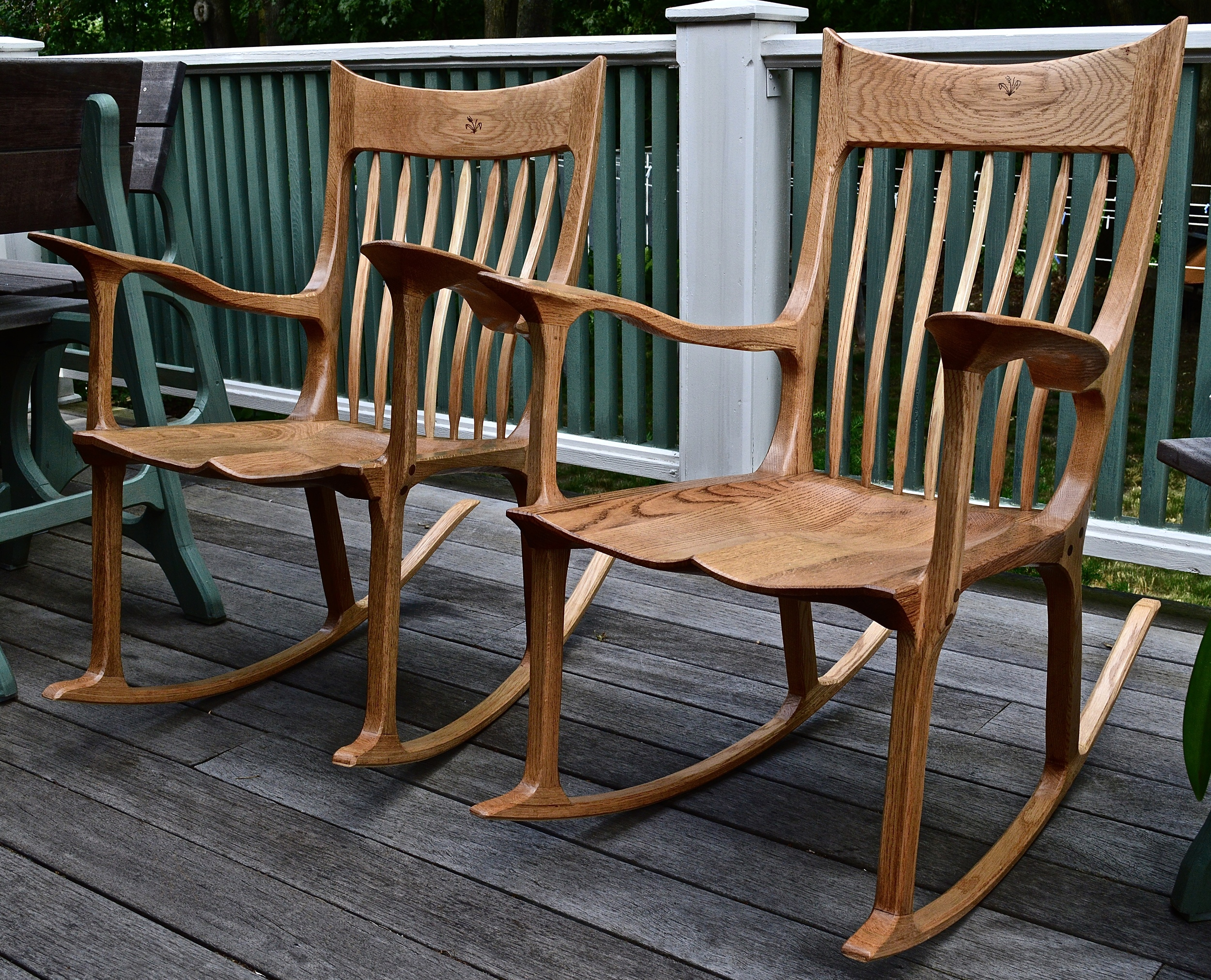 pair of oak rocking chairs