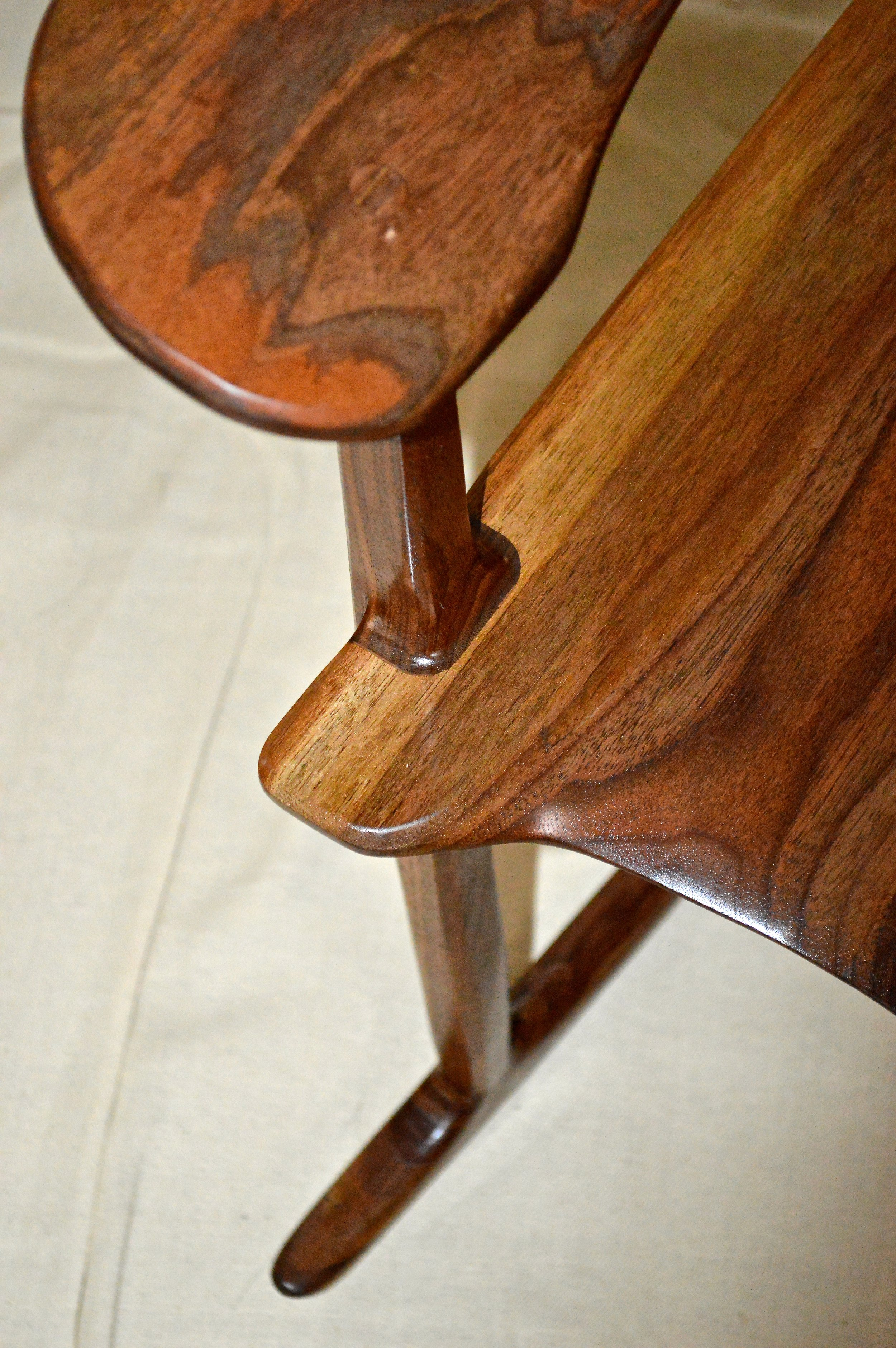 above: on the seat side after shaping and finishing the front leg, in black walnut