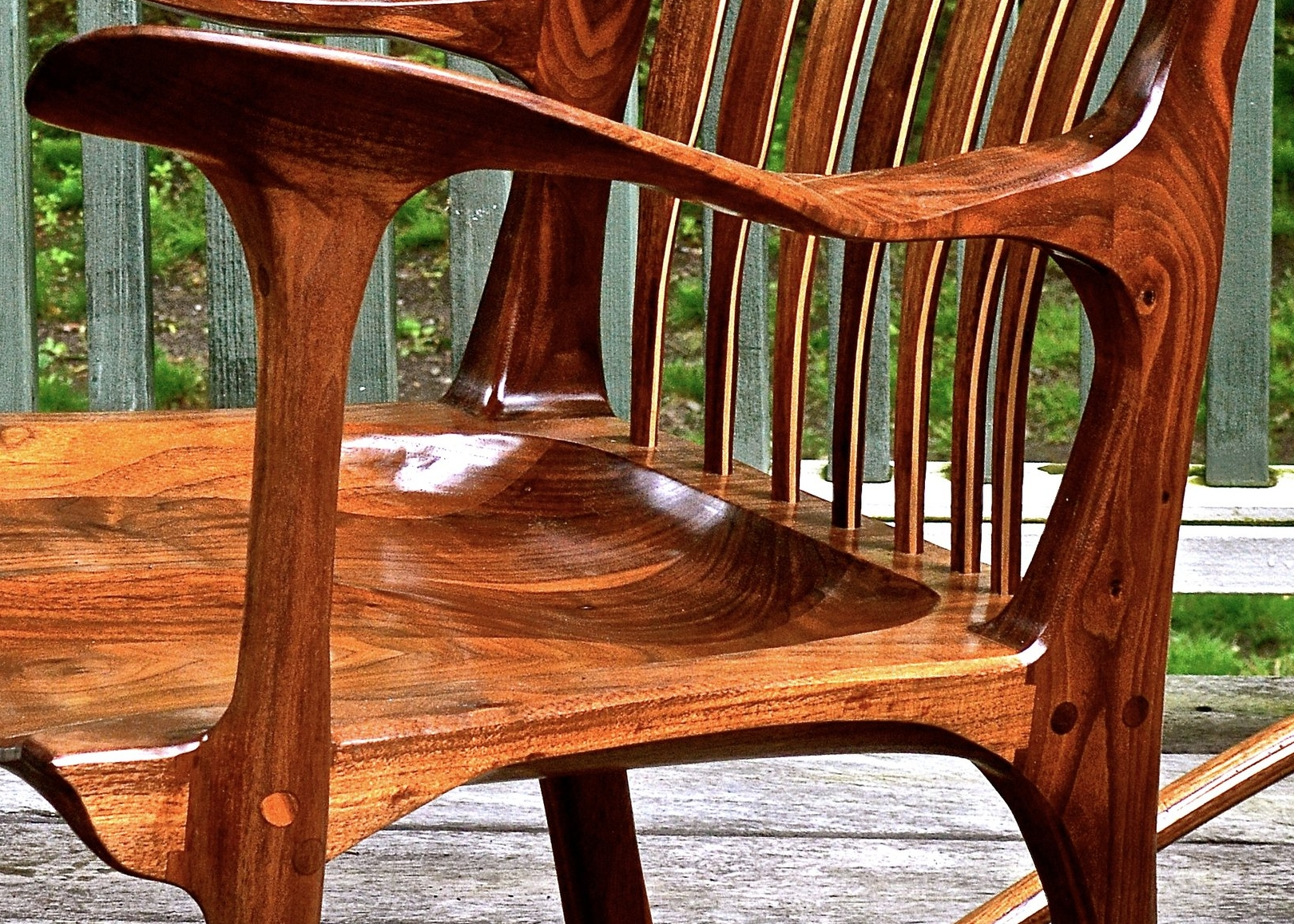 when finished, this joint is exposed and yet disappears, curving gracefully into the seat surface. also of note in this picture is the lines that carry from the legs into the arm.