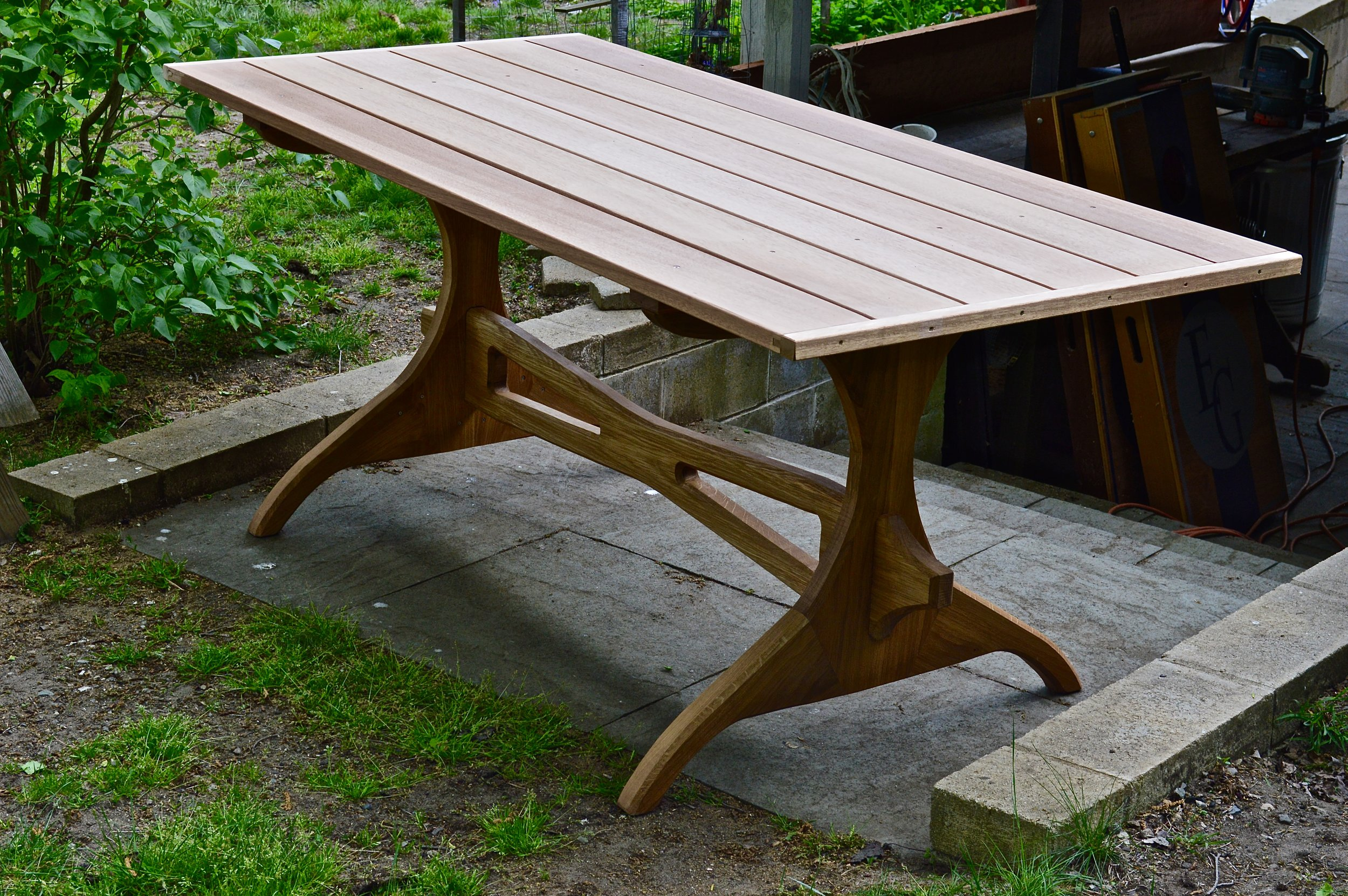 white oak and mahogany trestle picnic table