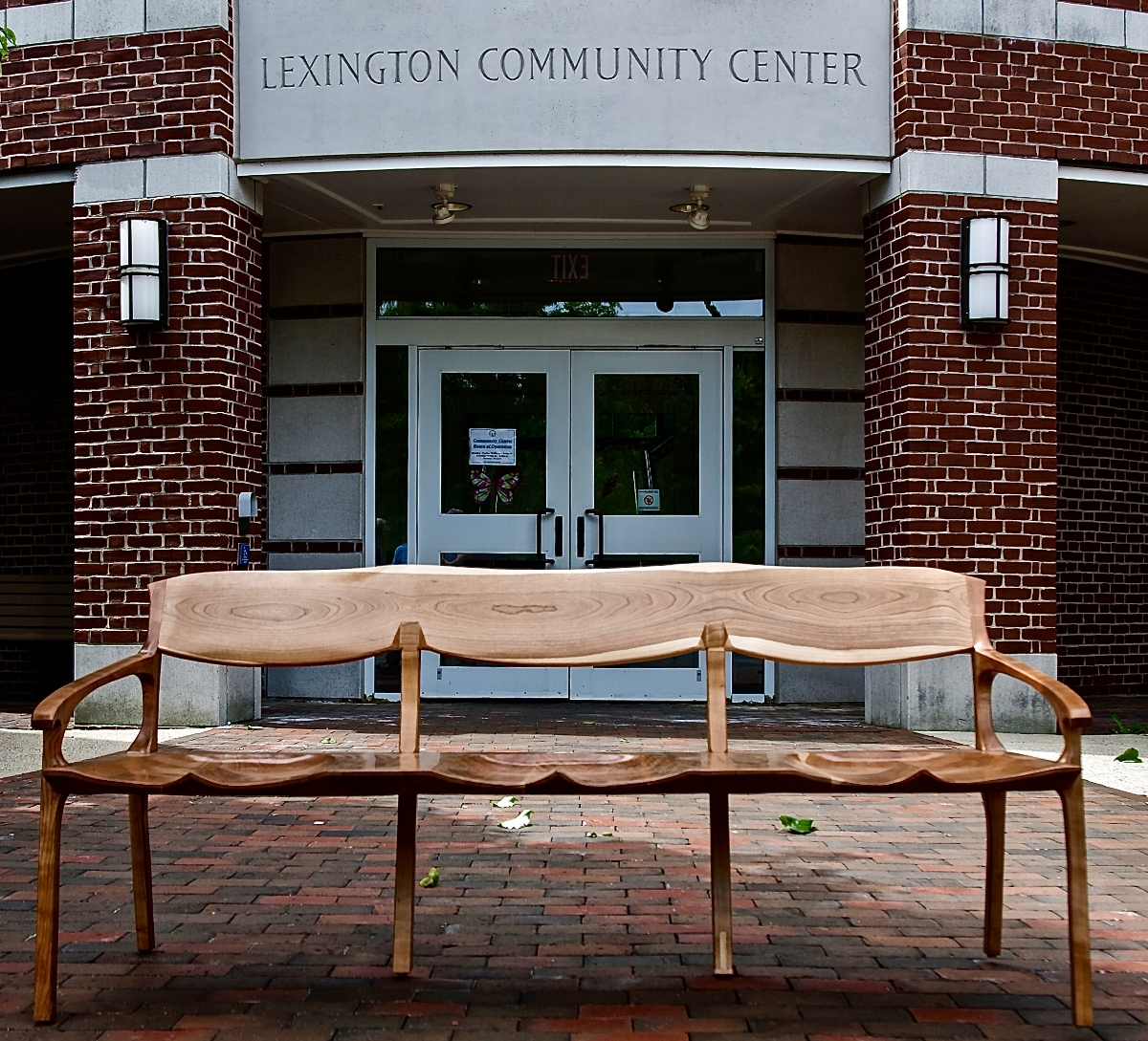 So I was approached to design a bench that the Lexington Woodworker's Guild would build and donate to the Lexington Community Center. The design is really an extended chair. The idea for the middle legs was stolen from the conoid chair that I built last year. A half dozen of us built it over the winter last year in the Woodworker's Guild shop, a real fun project.