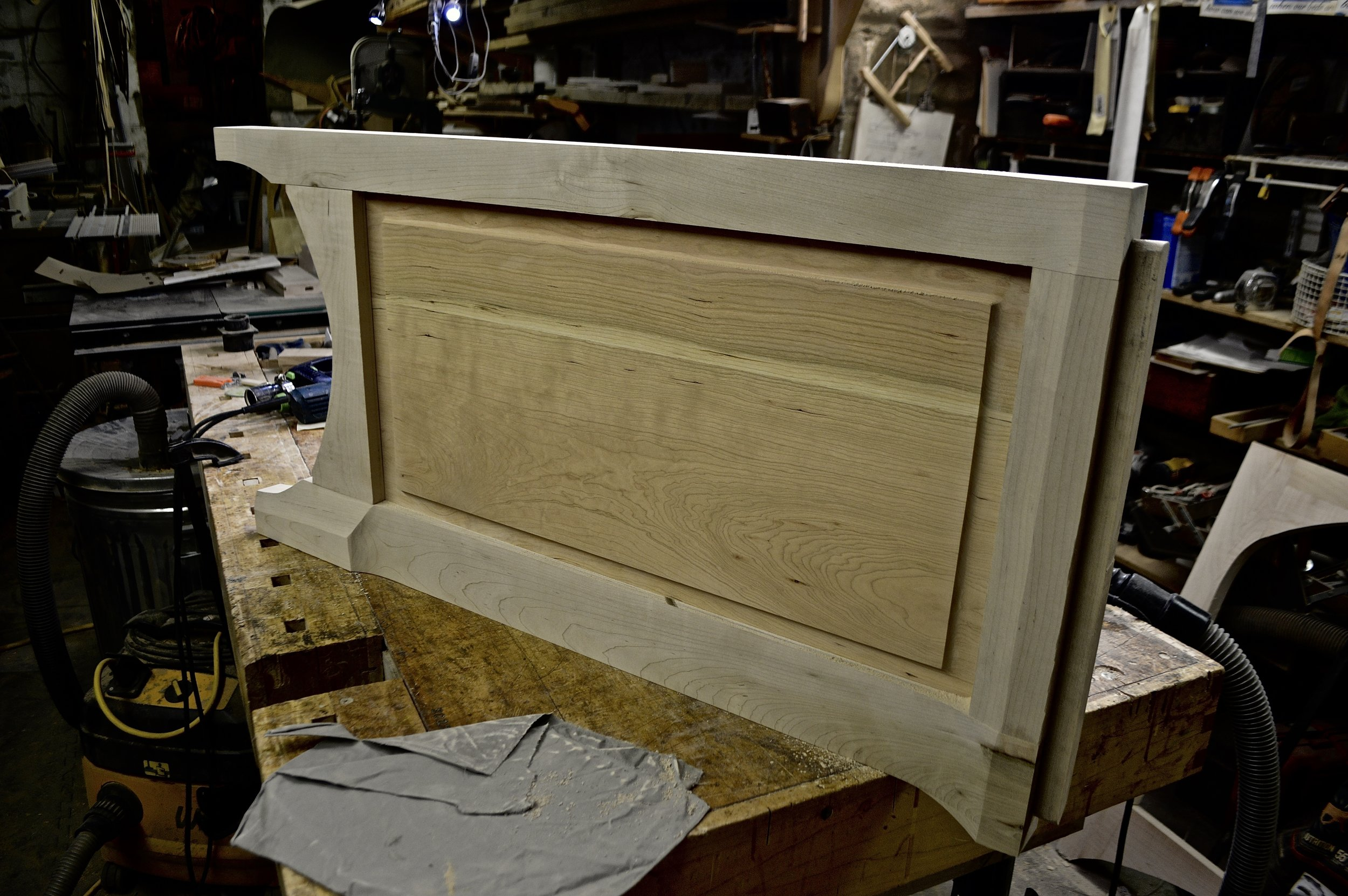 left end assembled with raised cherry panel male sliding dovetail for top on right