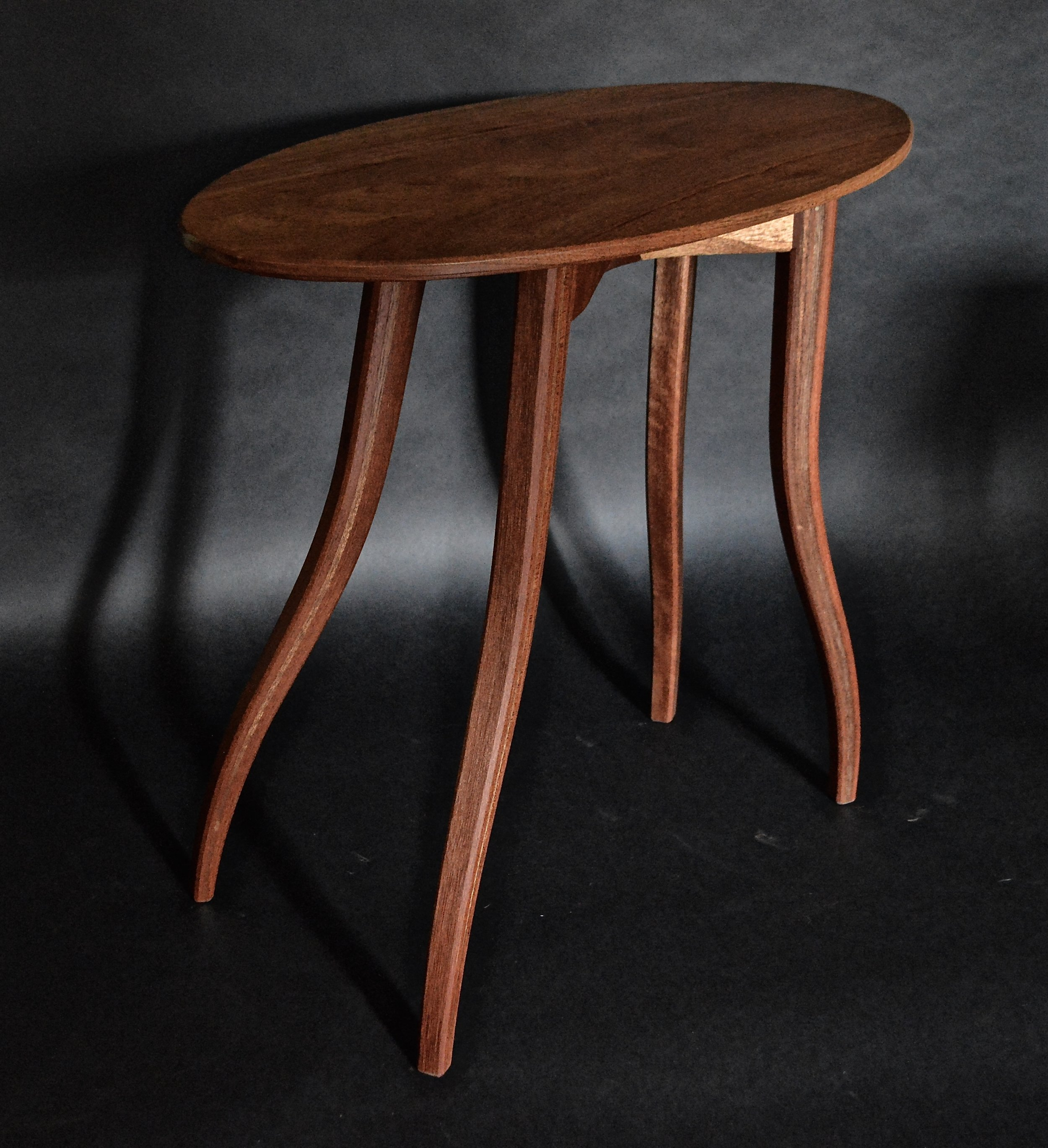 "elliptical red meranti ""walking"" end table"