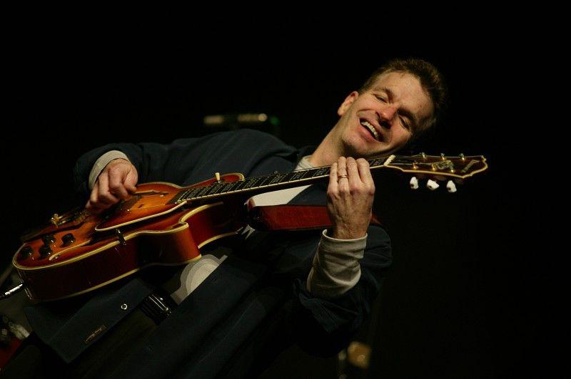 Mark Greel playing guitar in Boston