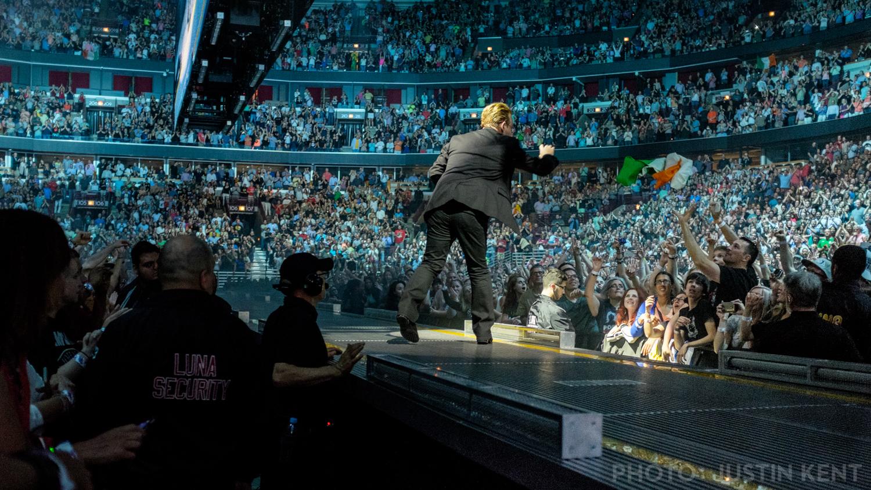 Bono returns the flag
