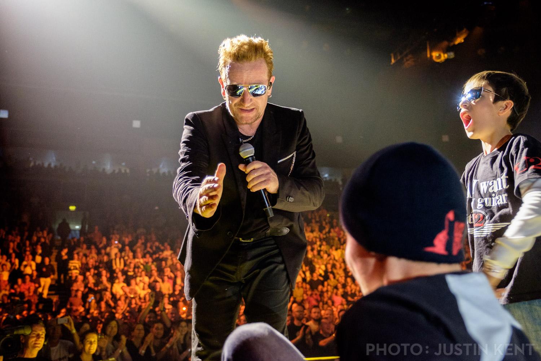 Bono helps Alex up