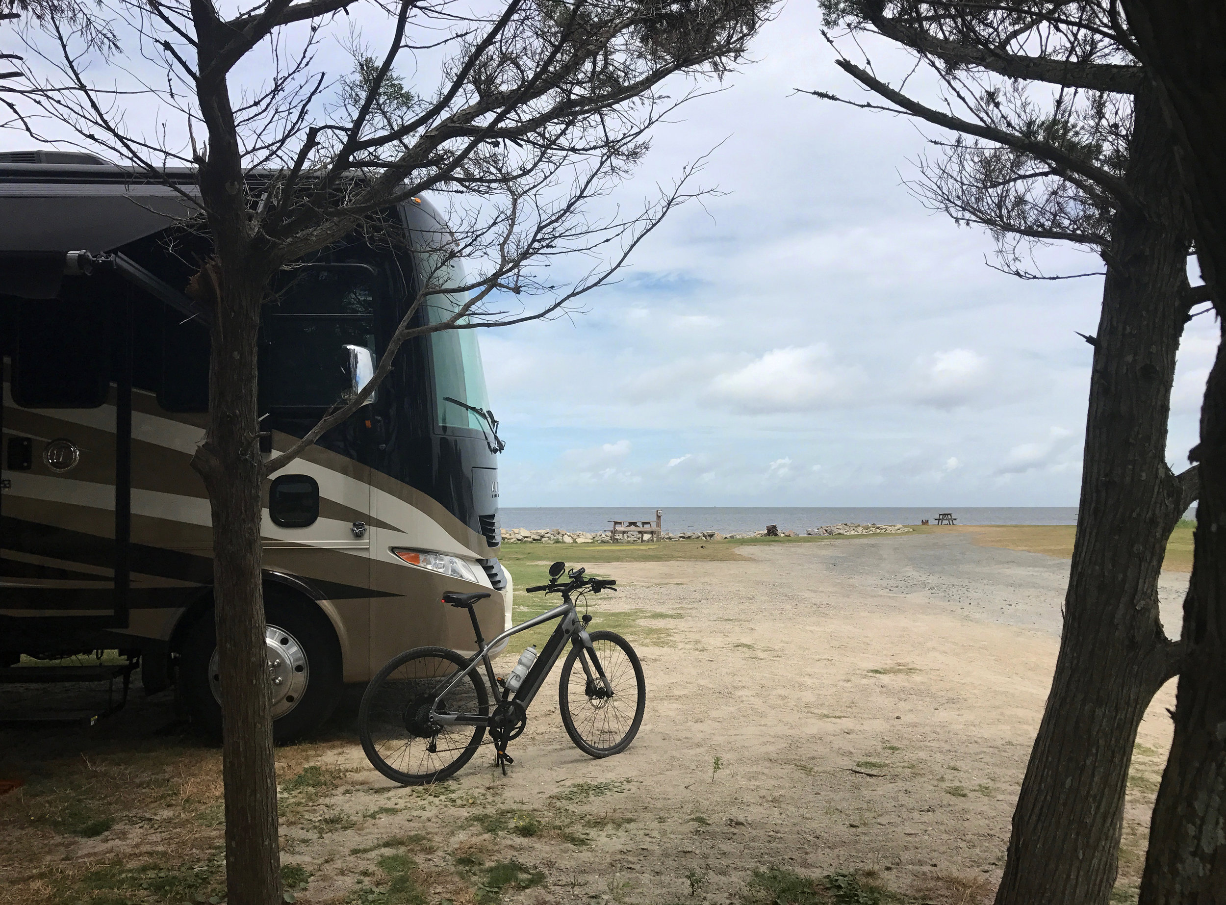 Rocky (our Tiffin Allegro 32SA) and his little pal at Frisco Woods Campground, with the Pamlico Sound in the background