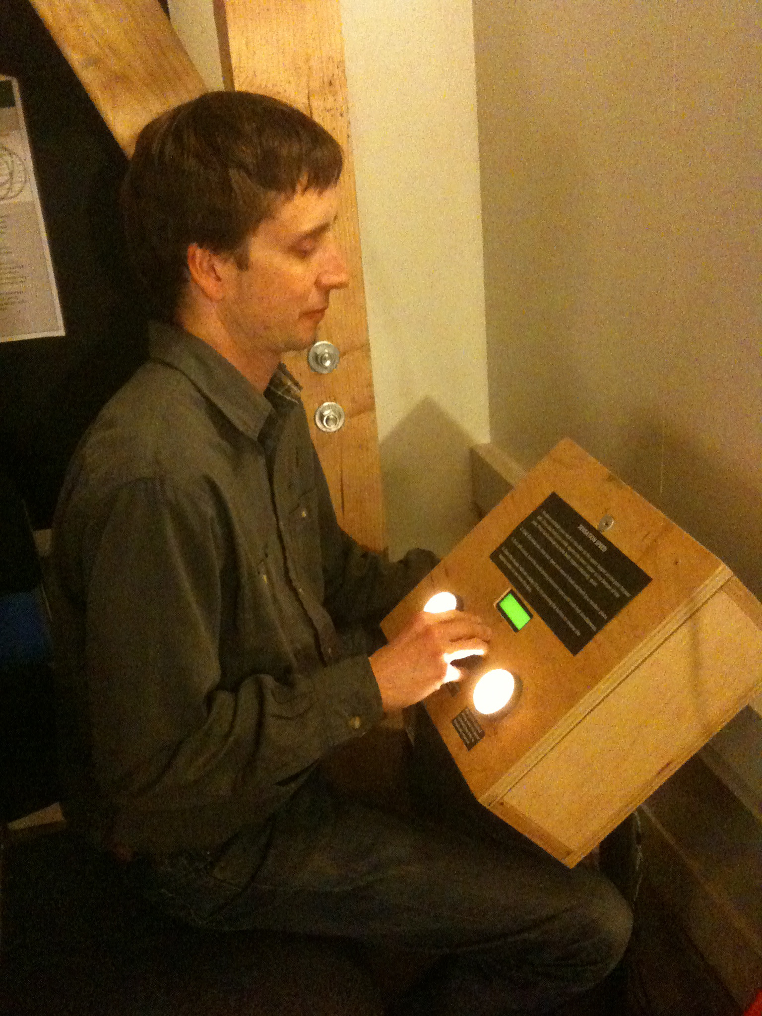 Visitor adjusts delay between shoulder and ankle tappers, until tapping feels simultaneous.  [early prototype]