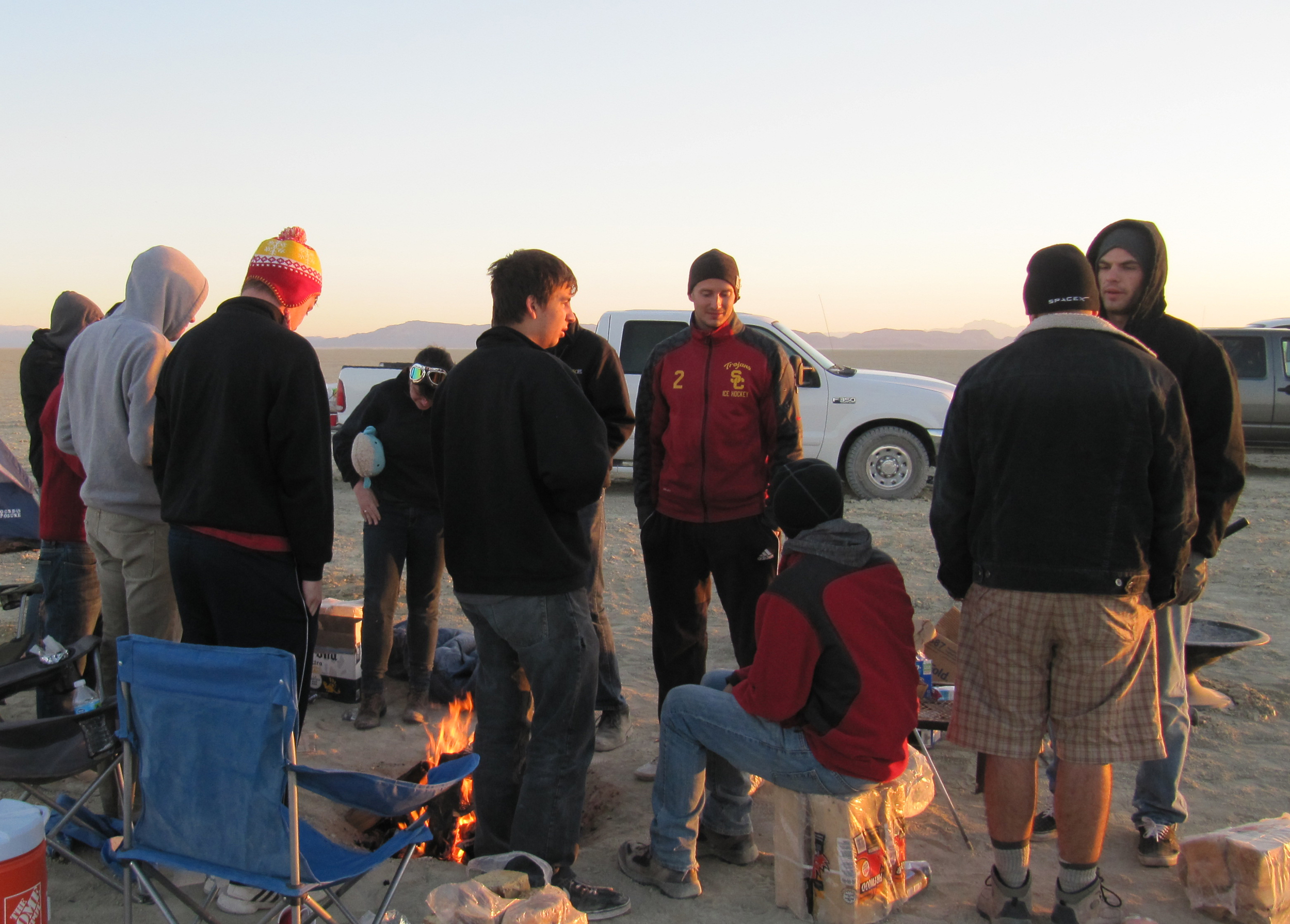 The team clings to the campfire at breakfast.