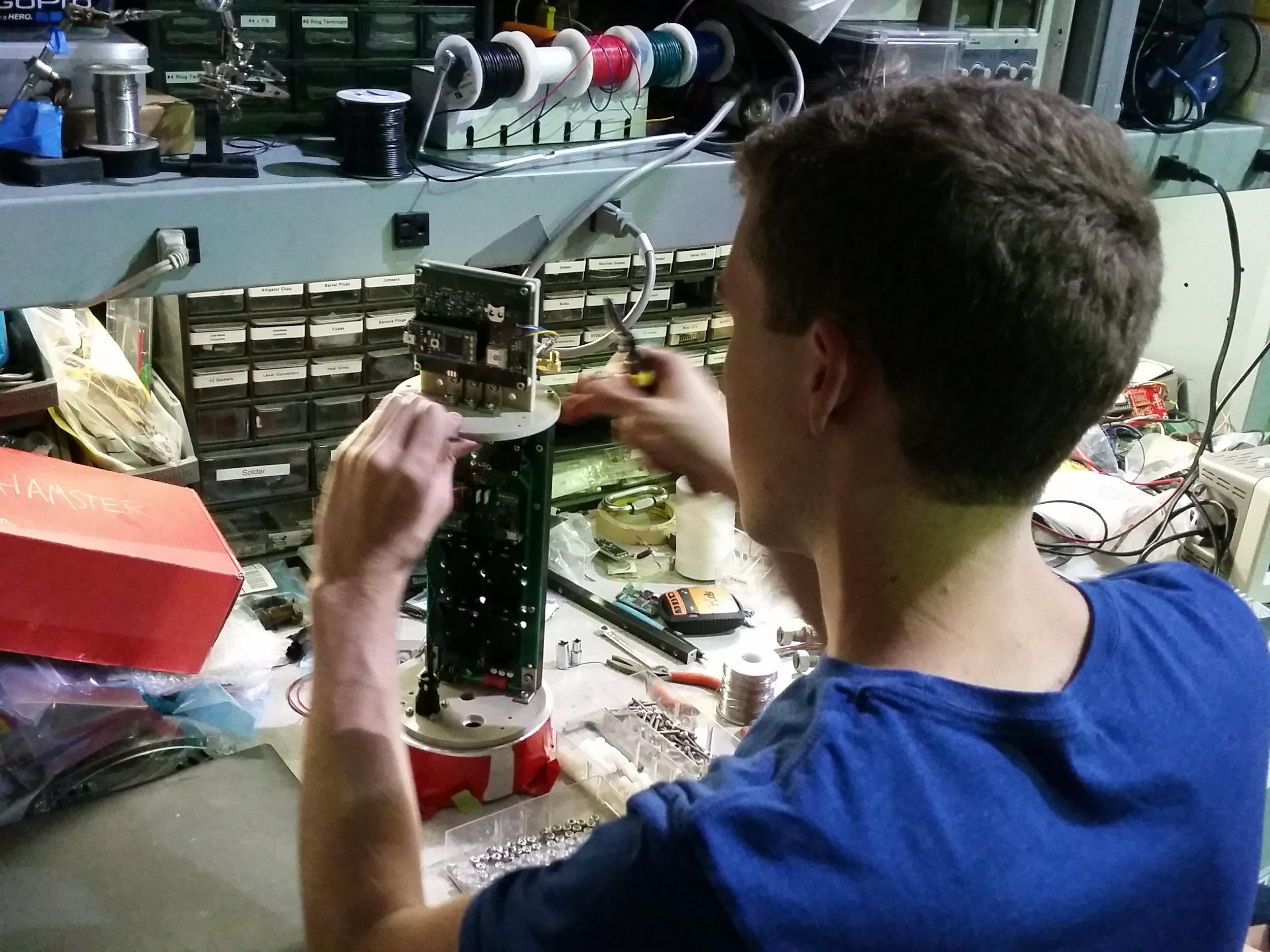 Carter assembling the avionics cartridge for flight