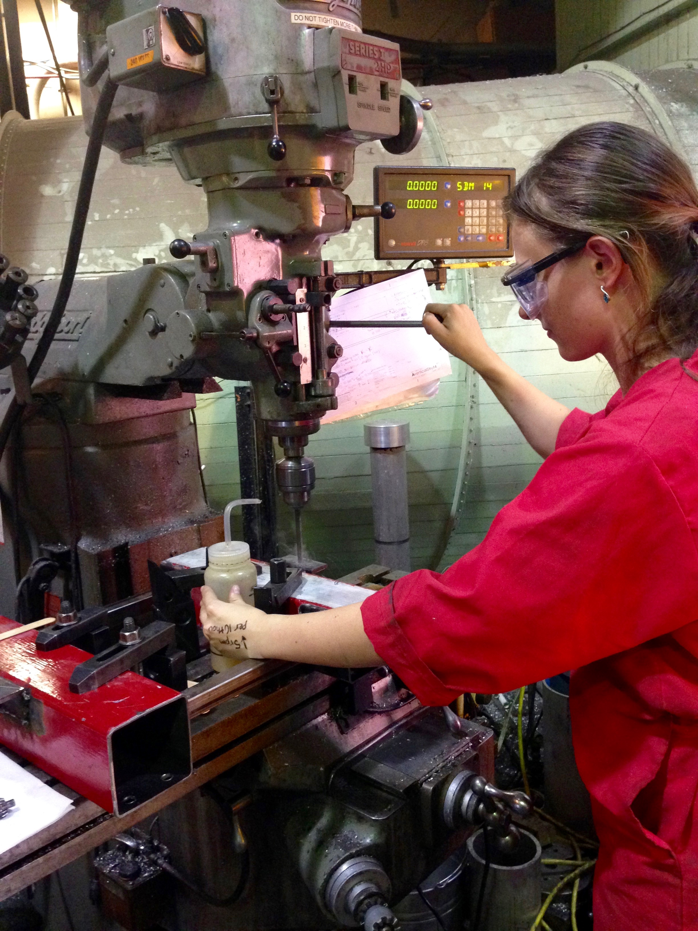Skye Mceowen machining the avionics unit structure on the mill