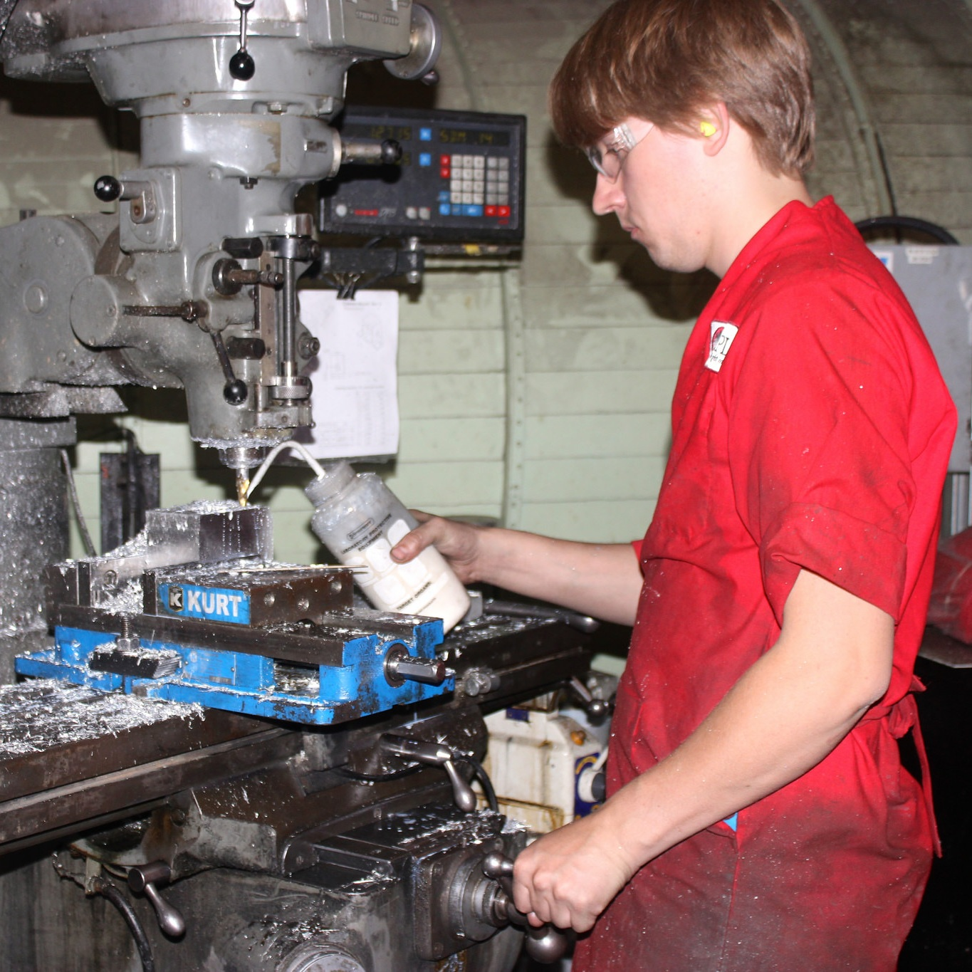Kristjan begins the long process of hogging out a camera mount from a block of aluminum on our Bridgeport mill.