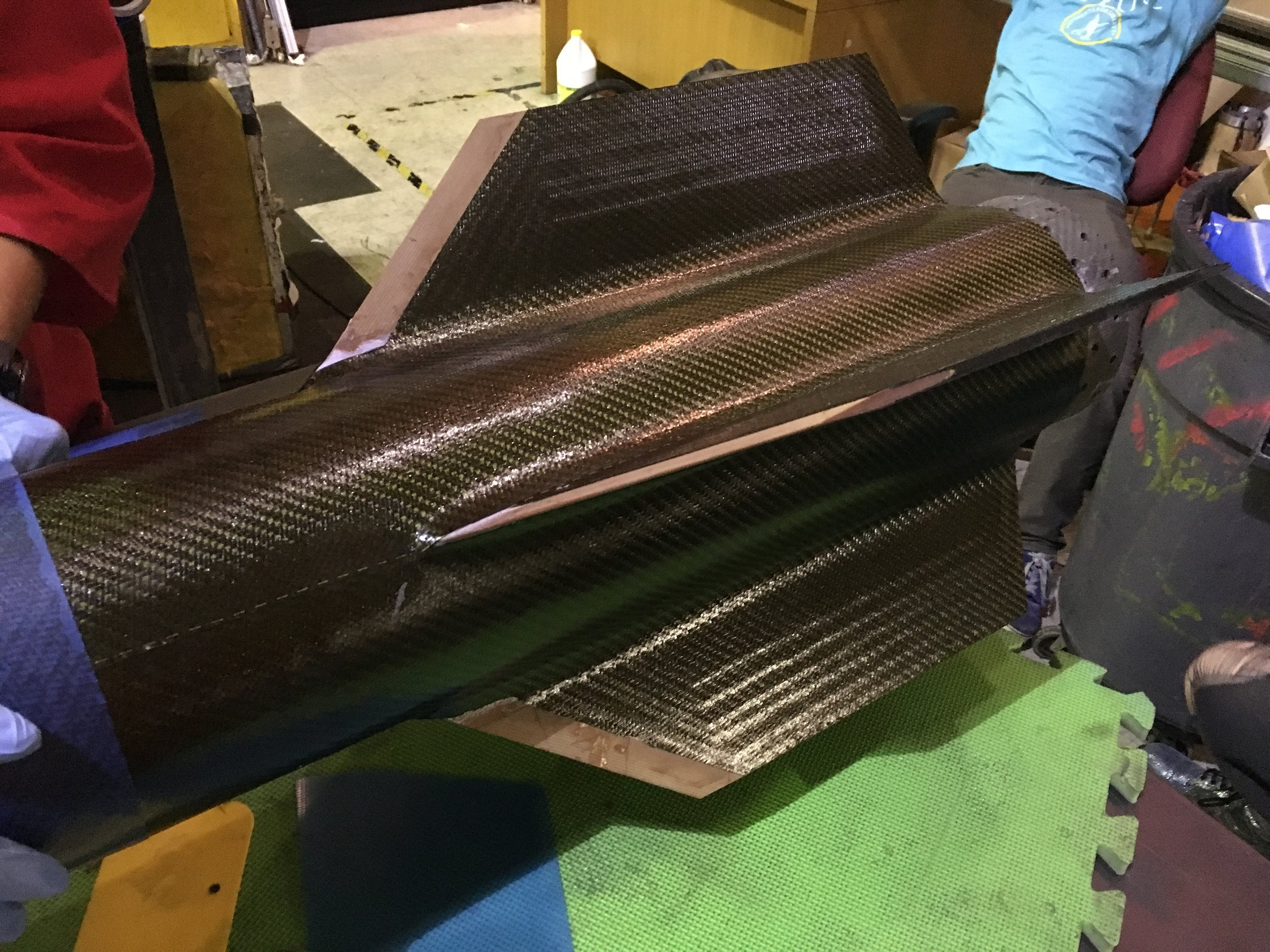 Part way through the tip-to-tip carbon fiber layup to secure the fins to the vehicle. This layup always takes longer than we expect, and Fathom II was no exception: this photo was taken at 1 AM, when we were about 10% of the way done.