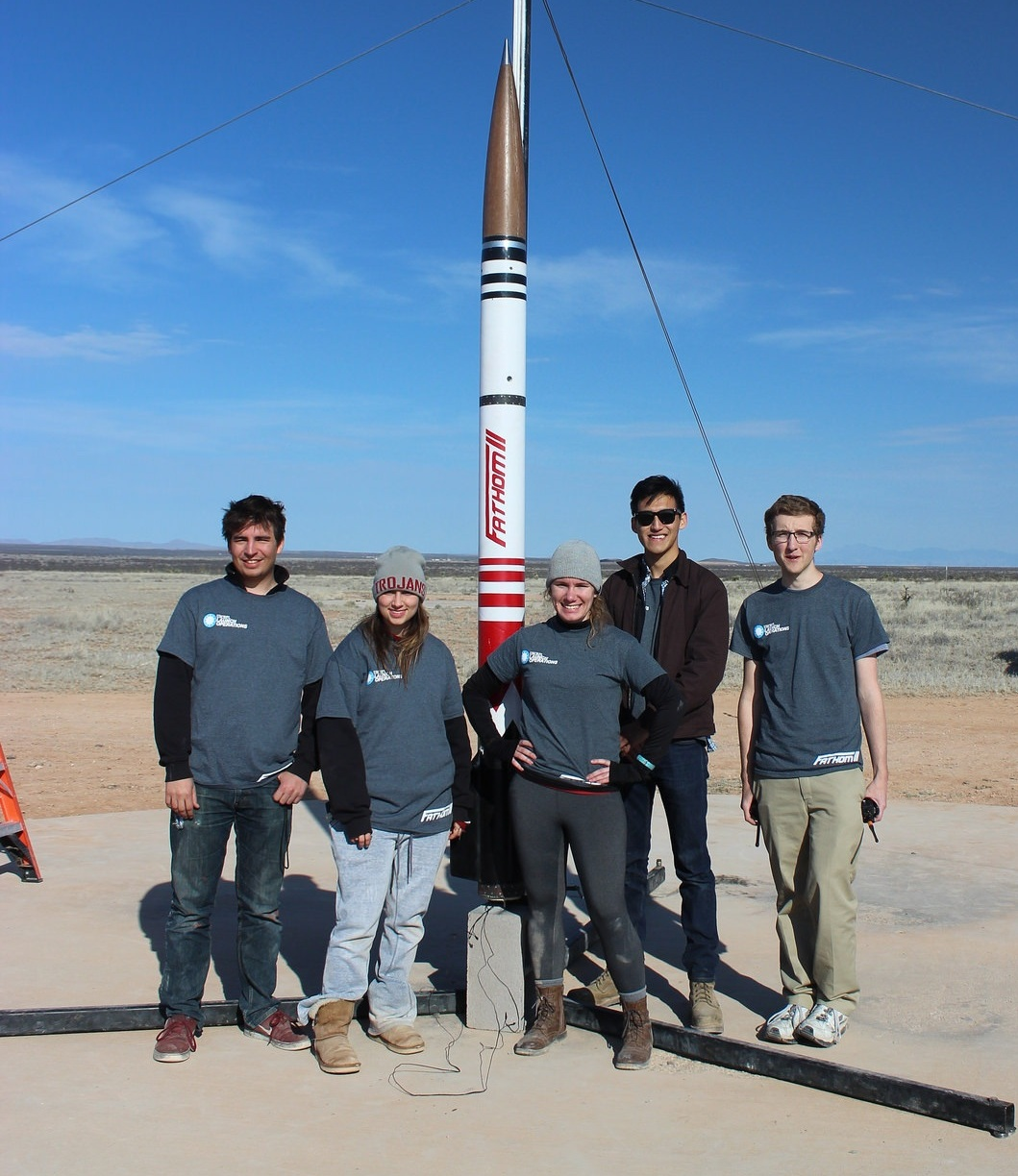 The launch operations team poses for one last photo with Fathom II before clearing the pad for launch.