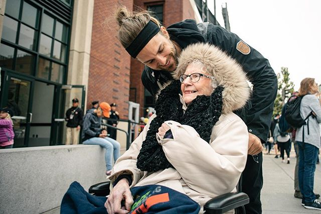 This is my best friend Alex and his 98 year old grandma Lorraine :) Today we (+ @clementinehonda #legend) drove to San Francisco and took grams to her first baseball game at At&t park! She LOVED IT. I'm sharing this photograph with you because it perfectly illustrates the point Im about to make. The beauty in a photograph isn't always about technical and compositional perfection. Emotion plays a very important role also. i.e. this photograph isn't technically perfect. There are distracting elements scattered throughout the background, hats, trees, colors and people. As a viewer all of these things take your attention away from the subject and it's a challenge to lock on without your eyes wandering all over the place. However. When you study Lorraines expression this photograph evokes a feeling in you. As a viewer you experience a similar feeling to what you'd expect Lorraine to be feeling in this moment. Empathy is established between you and Lorraine. Viewer and subject. This is what connection is about in photography. And as a photographer this is one of the most challenging things to create because it has barely anything to do with your camera and lens. It's all about your ability as a human being to reduce your presence around the subject in such a way as to allow them to express themselves fully … as if you weren't there at all. I'd love to know what are the feelings that you experience as a viewer of this photograph? I'll write mine as a comment tomorrow so as to not influence your thoughts. Thanks for reading :) - Daniel. ps. there are more photos and videos from this adventure in my stories atm! pps. Don't forget about your grandparents :)