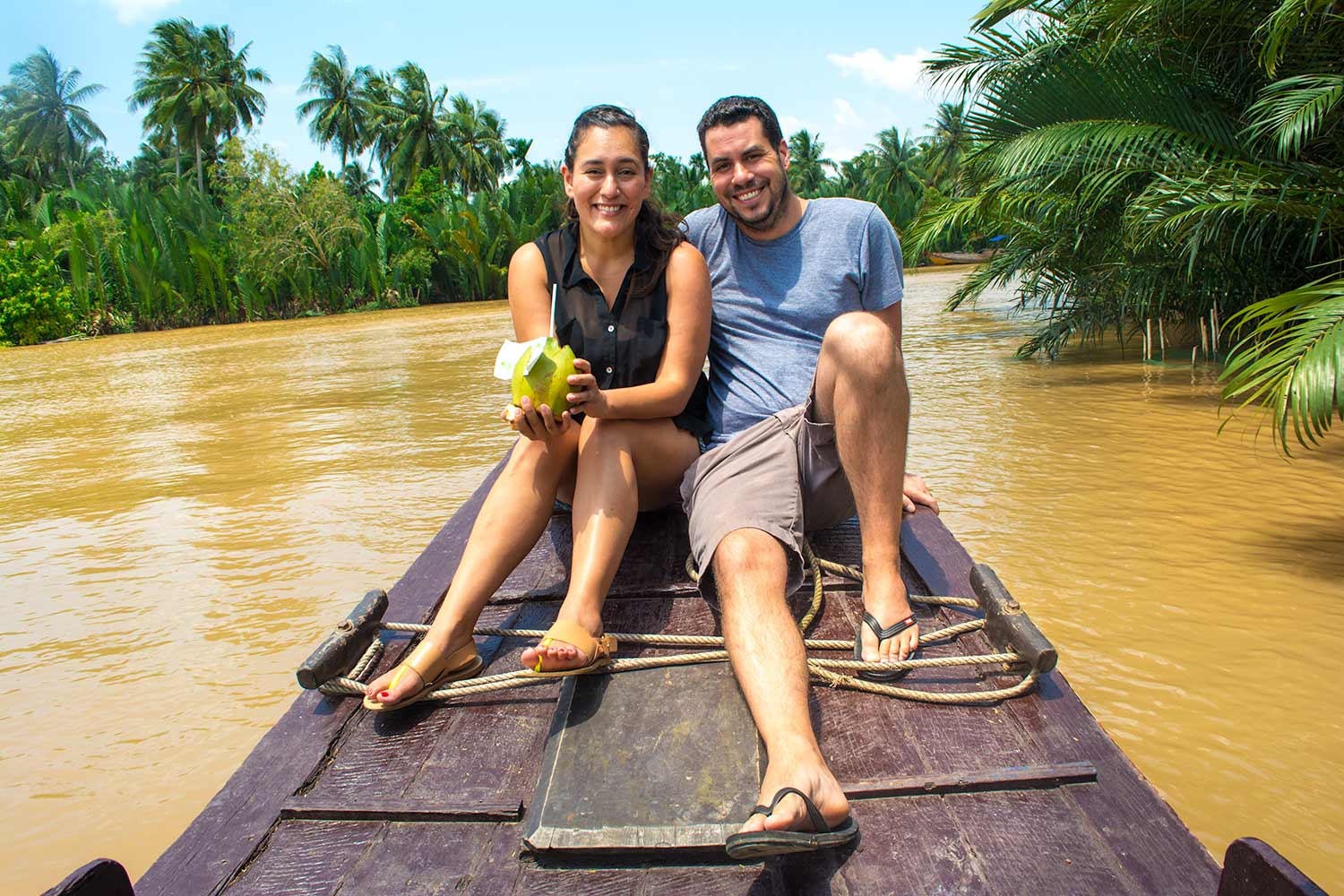Drinking fresh coconut on the waters of the Mekong Delta.