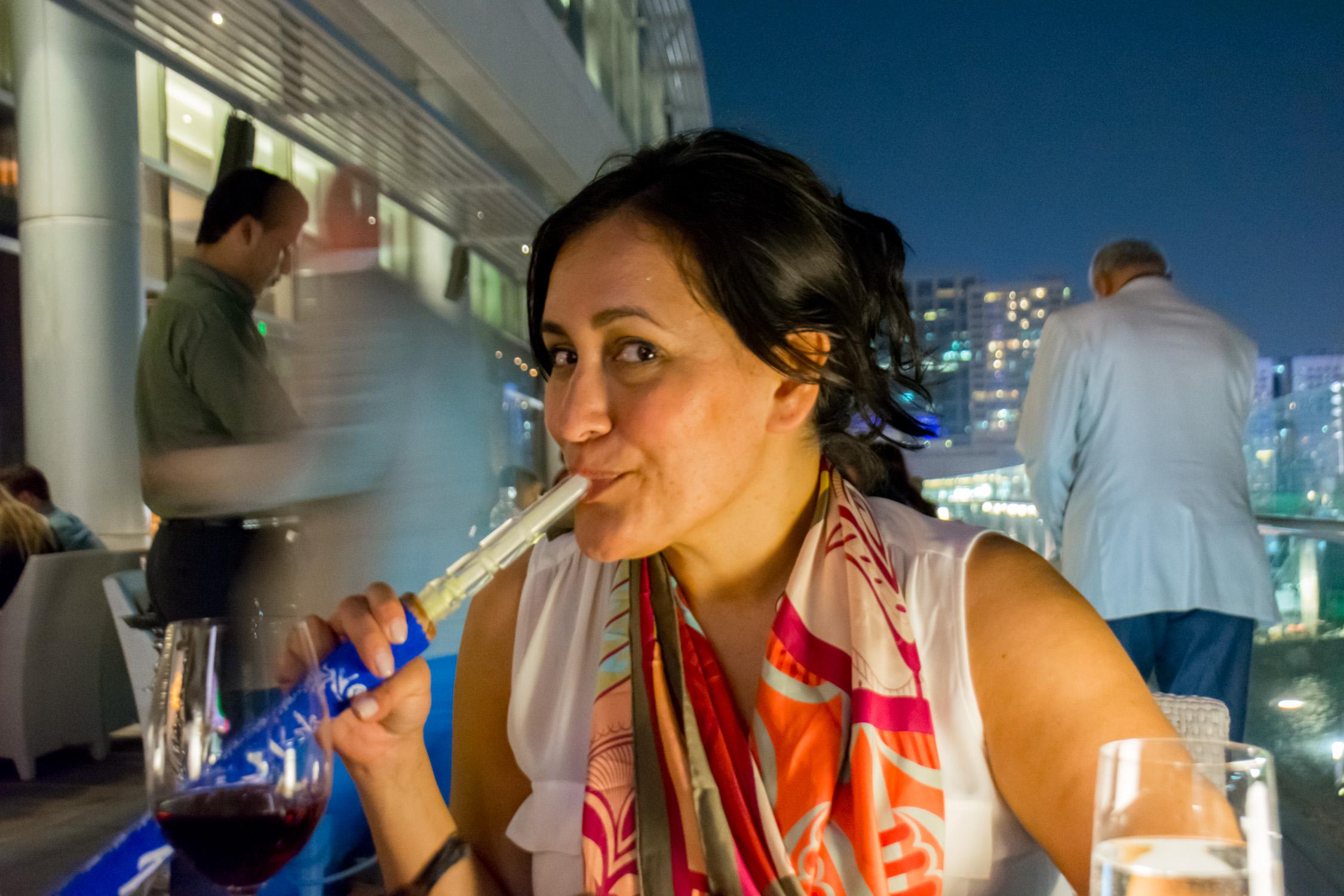 Smoking shisha at Sambusek at the Rosewood