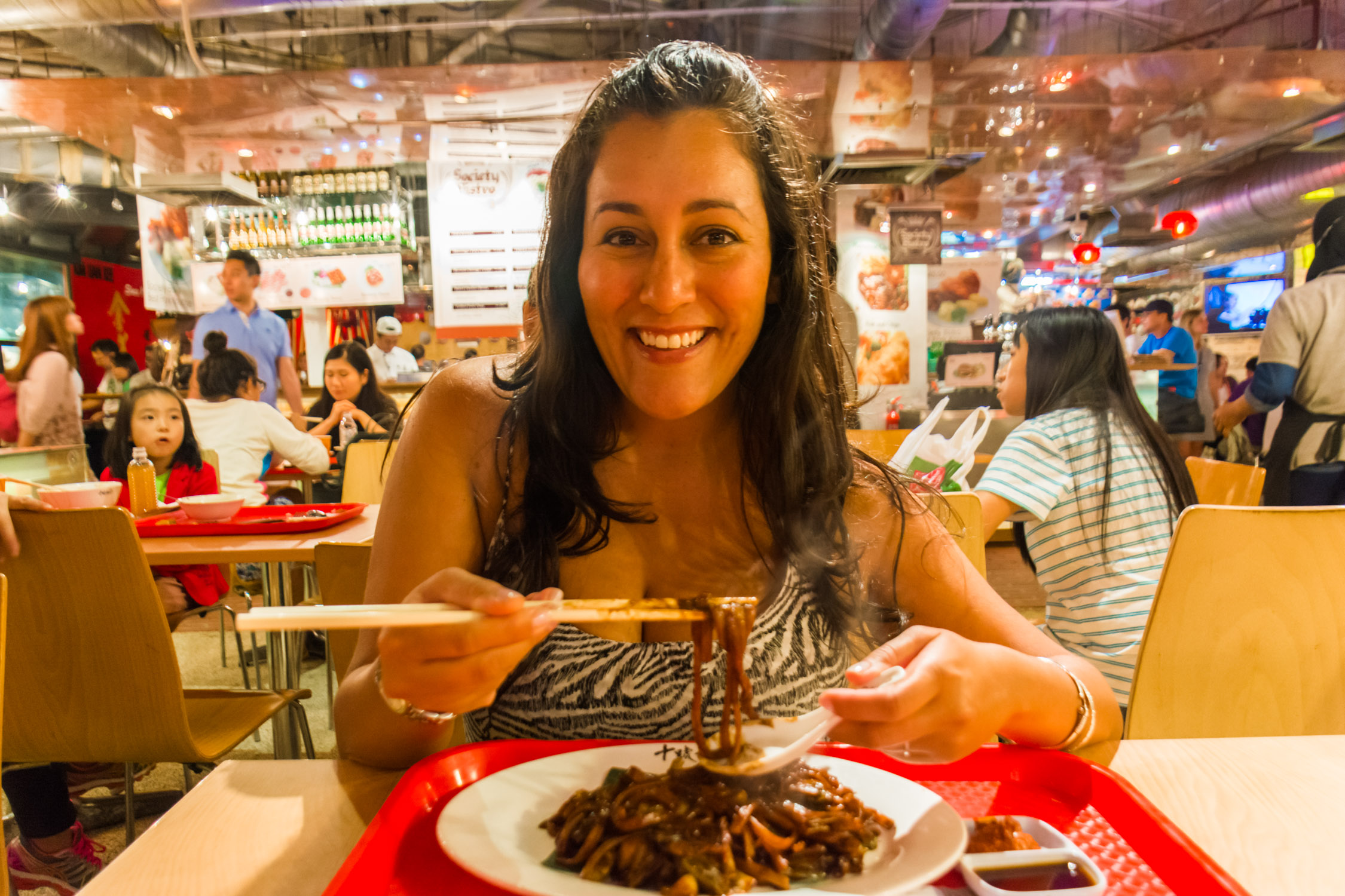 Danika diving into Hokkien Mee fried noodles at Lot 10