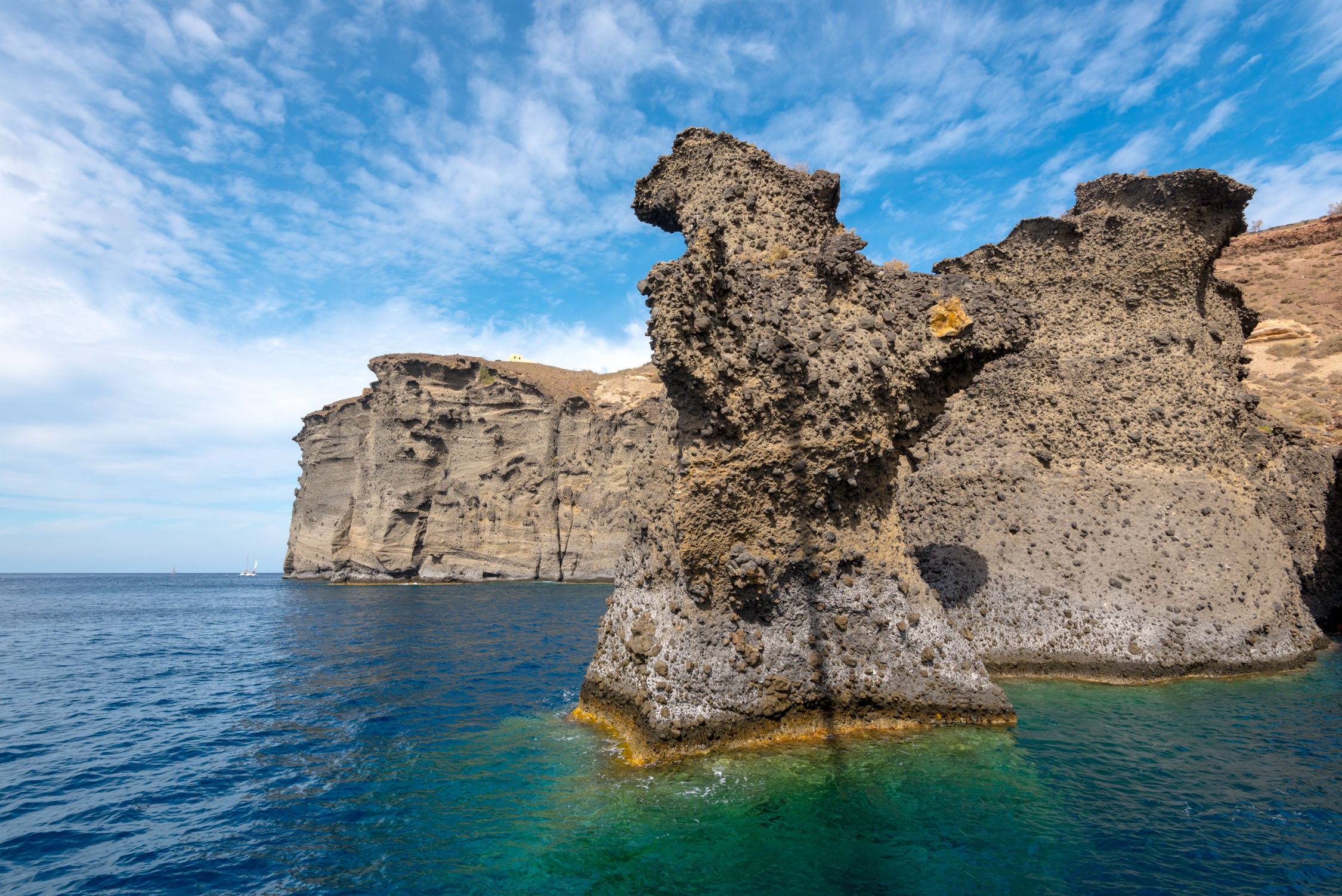 Rock formations scattered around the island of Santorini