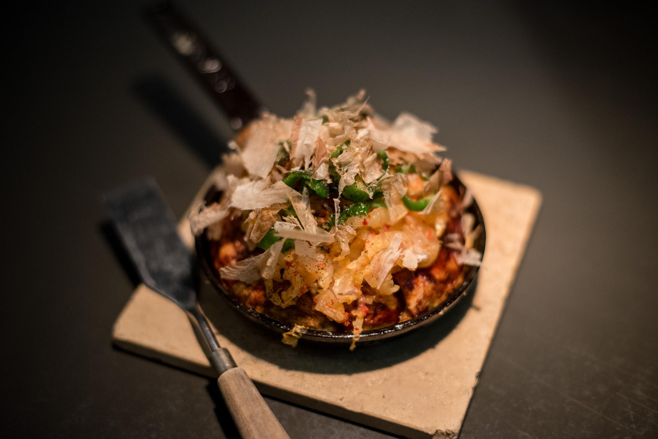 Okonomiyaki; A savory pancake loaded with all sorts of toppings