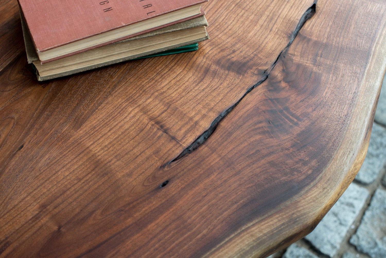 Farfala Table  Live edge walnut surface with Japanese joinery.