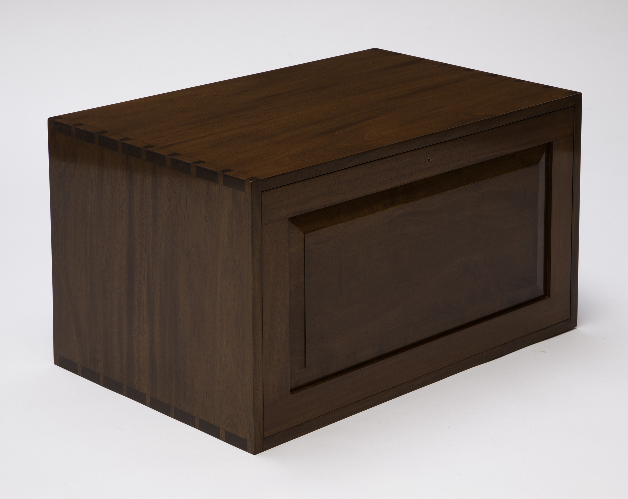 """This project started as a woodworks toolbox, but I couldn't bring myself to put woodworking tools in it, so my wife took it over as a cabinet to store her sewing supplies and tools.Mahogany is the primary wood used for the case and lid, maple for drawer dividers and cabinet back, pine for drawer sides, backs and bottoms.The case and drawers are joined together with hand cut dovetails. Drawer bottoms are raised panels on three sides and housed in grooves running along the drawer sides and fronts, and are screwed to drawer backs. Drawer pulls are maple Shaker style knobs turned on a lathe. The case back is ship lapped maple panels set in a rabbit and held in place with brass screws. There are five drawers of varying sizes. The lid fits in front of the drawers and is stored in the top of the case when not being used. A mahogany brown dye, mahogany brown stain,shellac and a truck load of elbow grease were used to finish the piece. This cabinet has already found a home, but we would be glad to work with you to create your own. This cabinet priced out at $3000.00.Dimensions: 29"""" W x 16"""" H x 17"""" D. (Click on the picture to see how it was put together.)"""