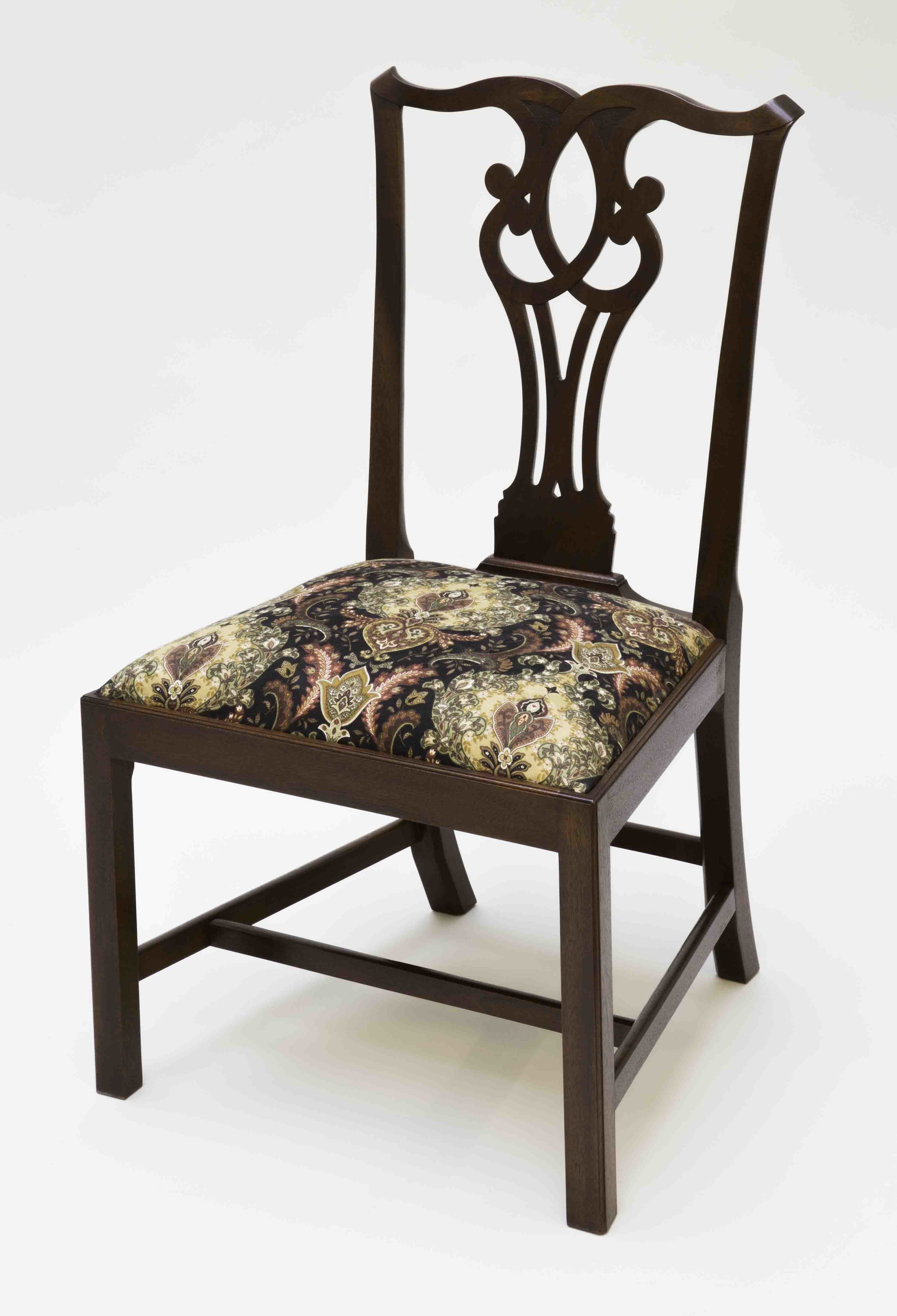 """This is a Chippendale side chair. The chair frame is mahogany, slip seat frame is ash, glue blocks are pine. Muslin, horse hair, two inch webbing,black cloth and cotton stuffing are used for the slip seat cushion. A formula of orange dye, brown walnut dye, brown walnut pigmented stain were used to achieve the rich color. A shellac was applied by hand (French polish). This chair is for sale for $1800.00.Dimension: 21 1/2"""" wide x 38"""" high x 17 1/2 deep. (Click on the picture to see how it was put together.)"""