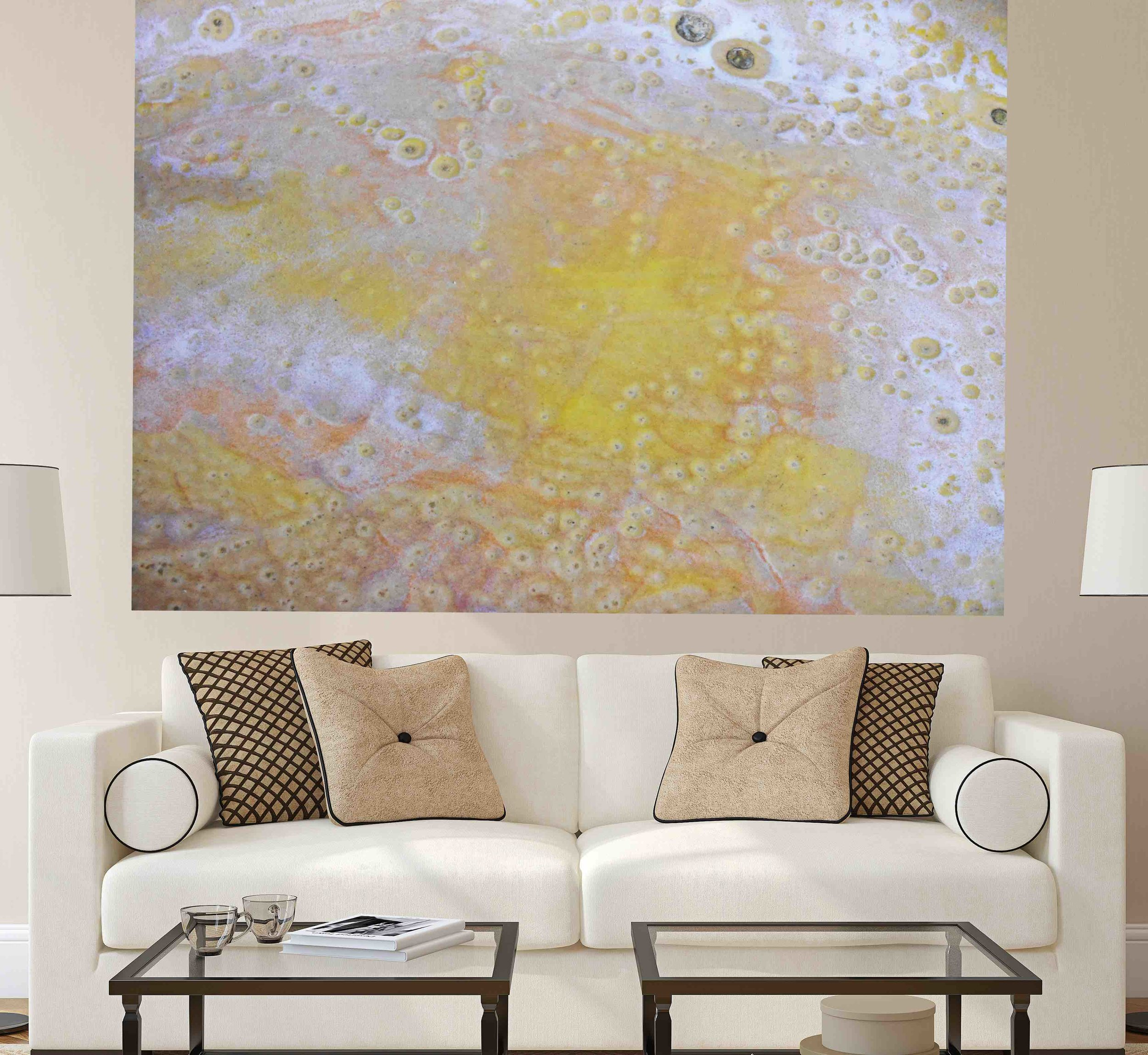 large contemporary painting on behind a sofa