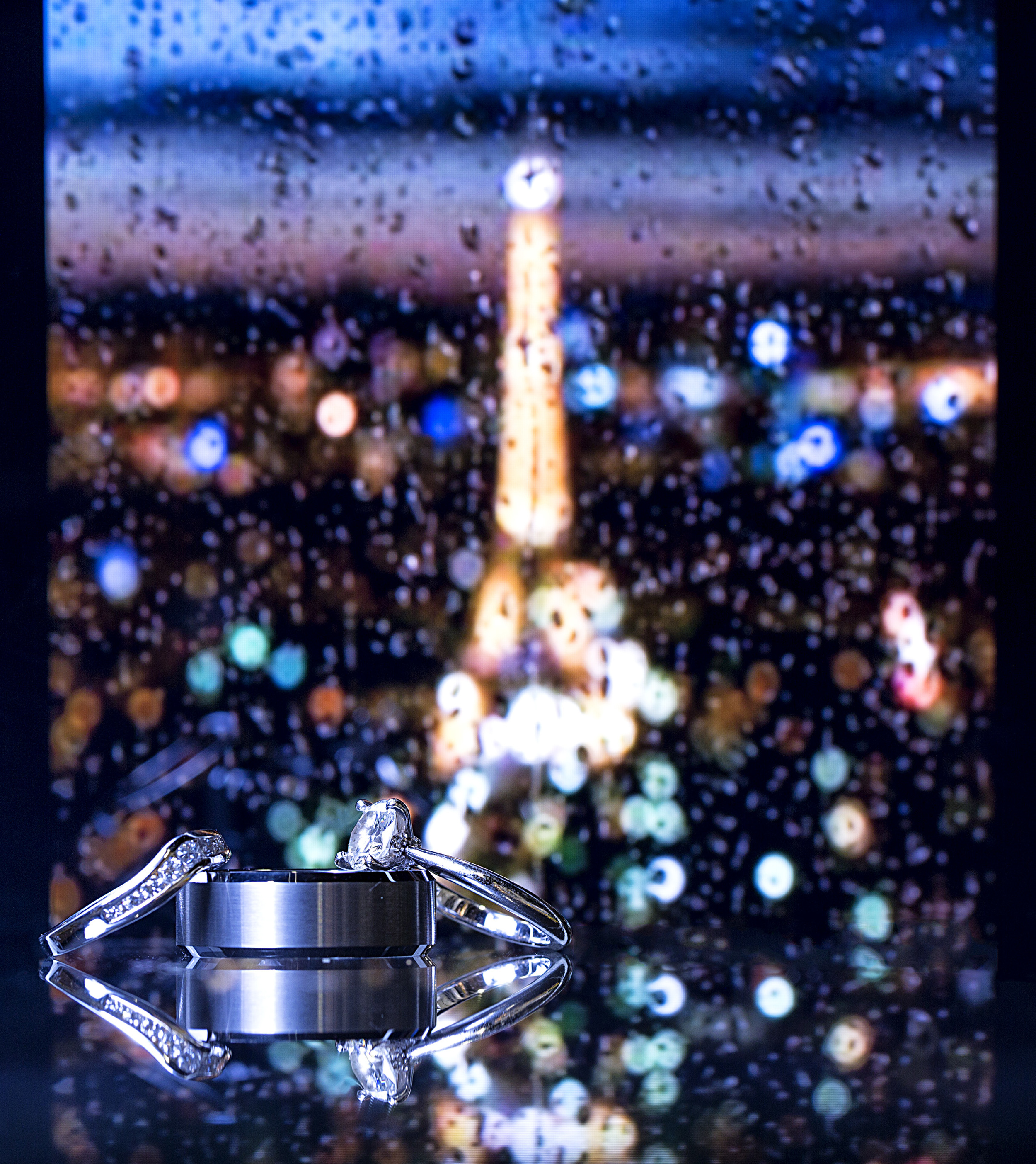 Paris. Looking through the Honeymoon Suite window on a romantic, rainy evening with the Eiffel Tower lighting up the night.