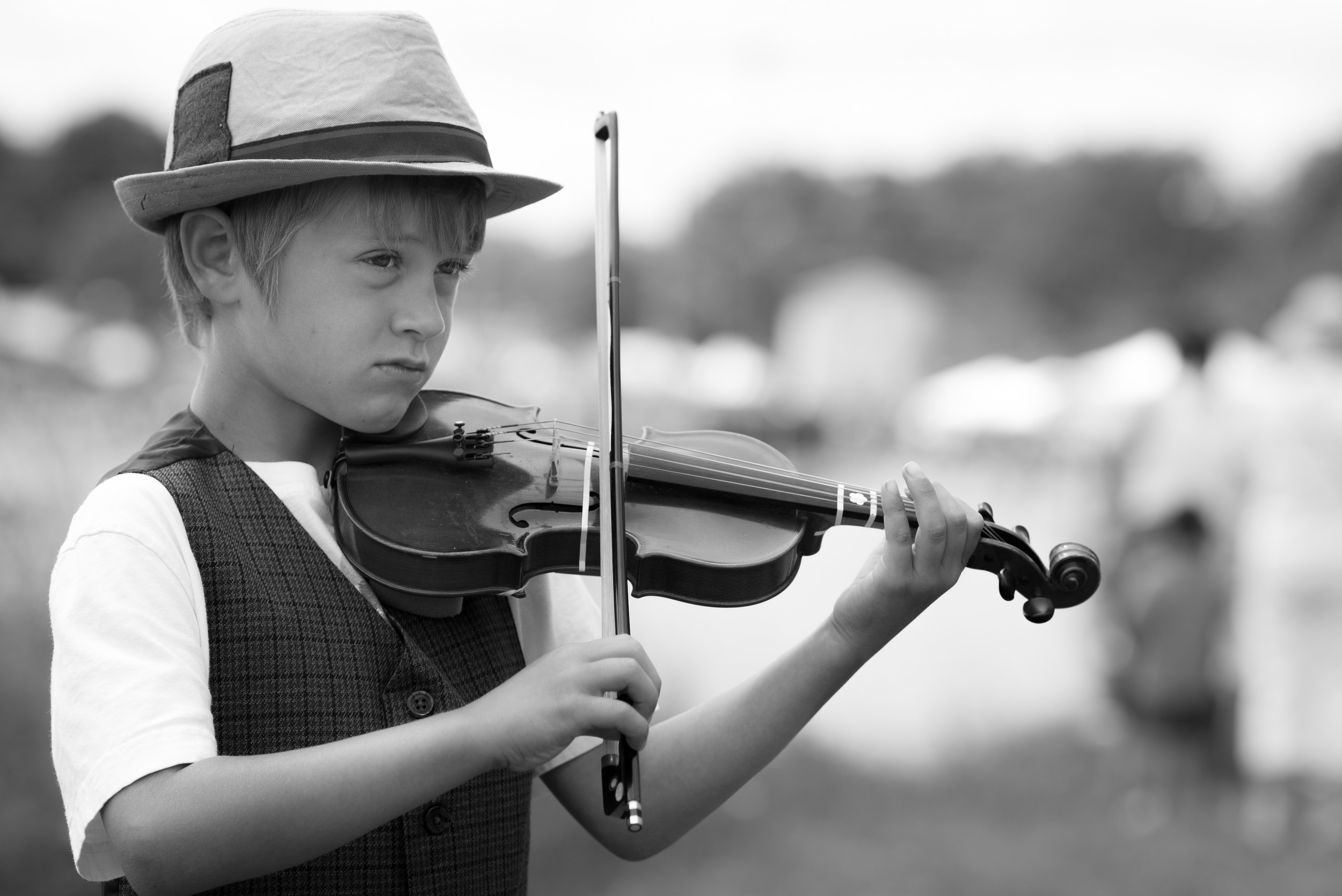 """Definitely the best thing I saw at the lake today was this young feller and his brother. They were taking turns stepping forward and playing tunes. In the fiddle case was a note, """"DS Fund."""" They were trying to raise some cash to buy a Nintendo DS, I hope they made a killing because they were really good."""