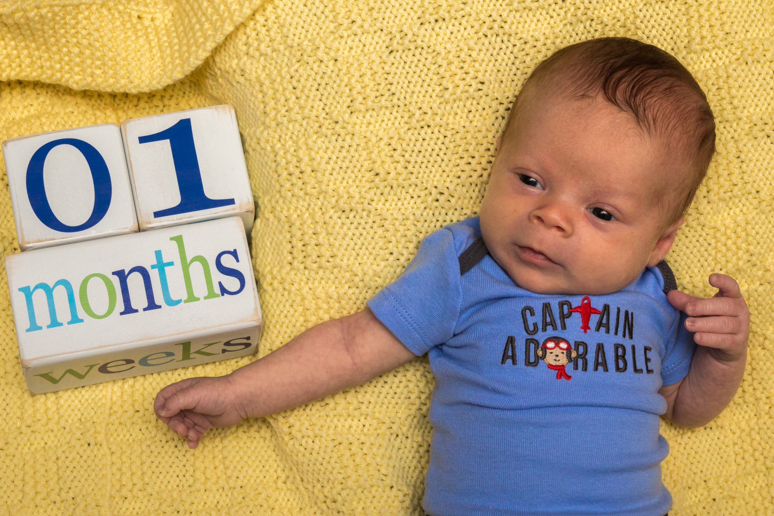 One month old. He truly is Captain Adorable.