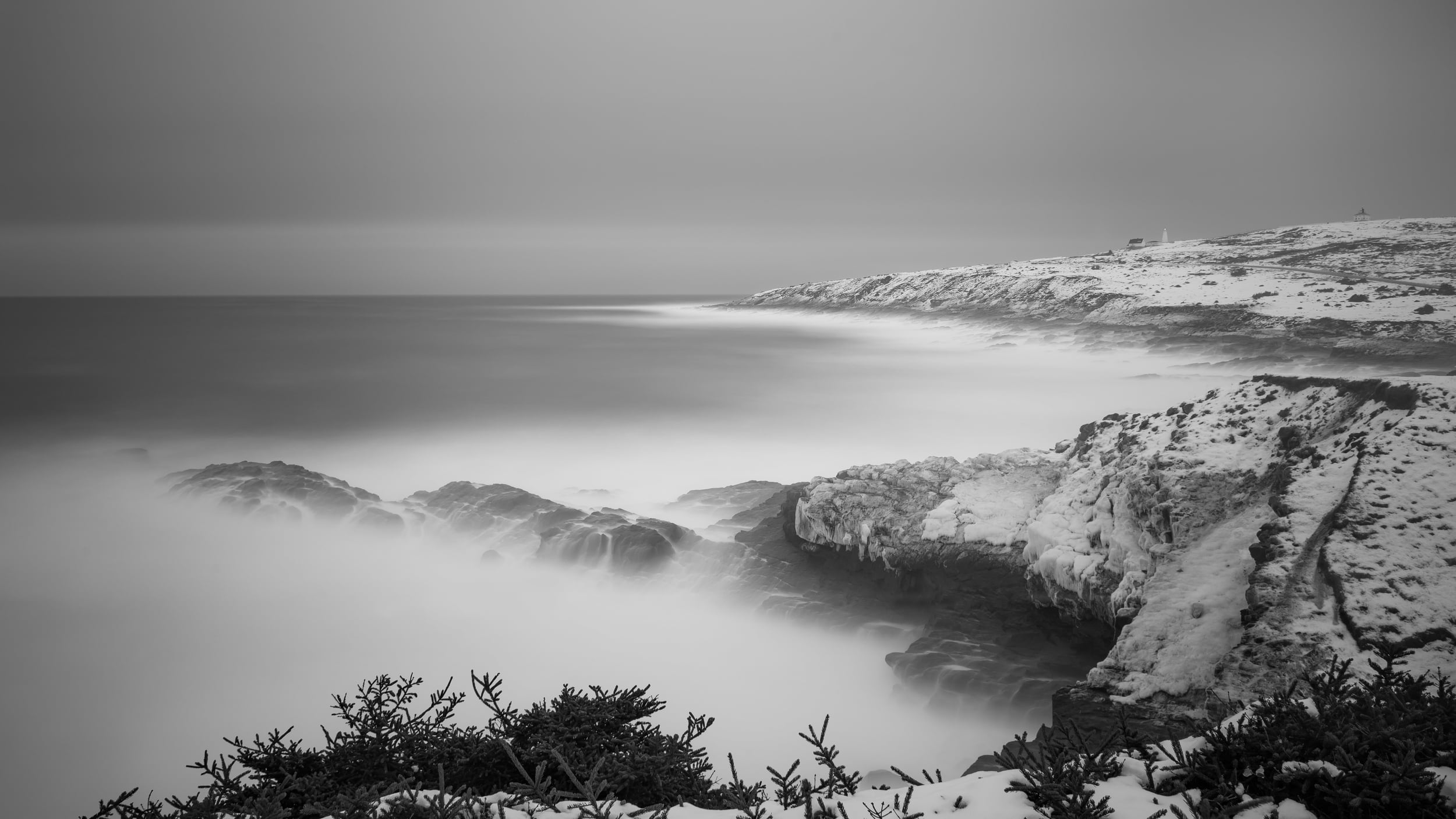 This is a three-minute exposure calming the otherwise violent waves. Time fixes everything.