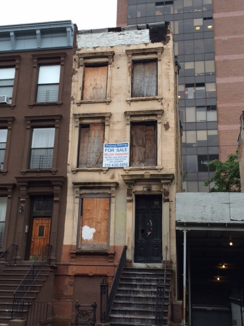 Central Harlem brownstone in need of a lot of work