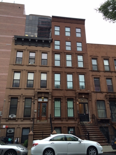 Fully renovated Central Harlem brownstone with owner's triplex and rental units