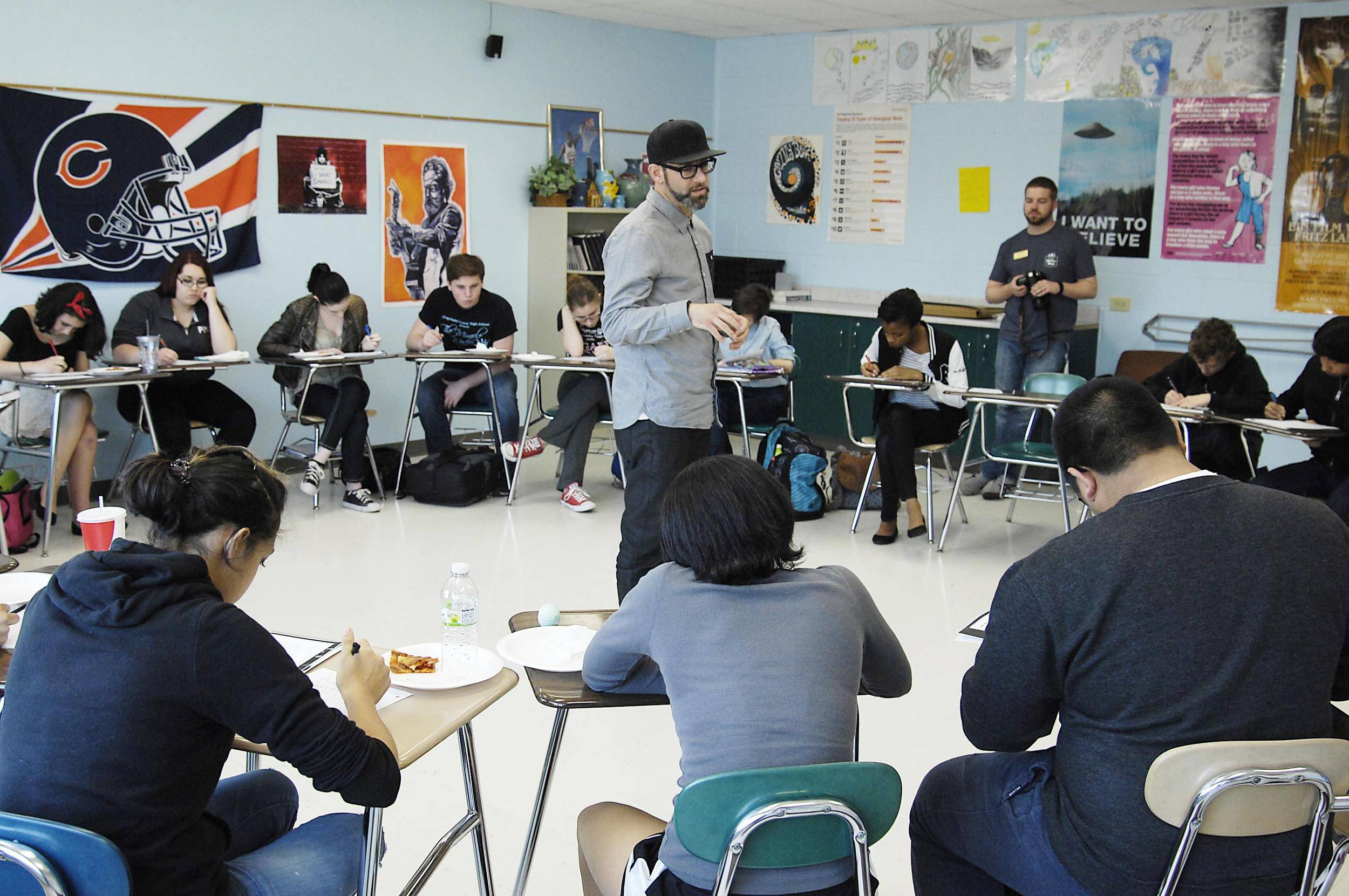 Poet Kevin Coval of Young Chicago Authors facilitates a classroom workshop at GCHS Writers Week 2015. Photo by John Starks/Daily Herald. Used with permission.
