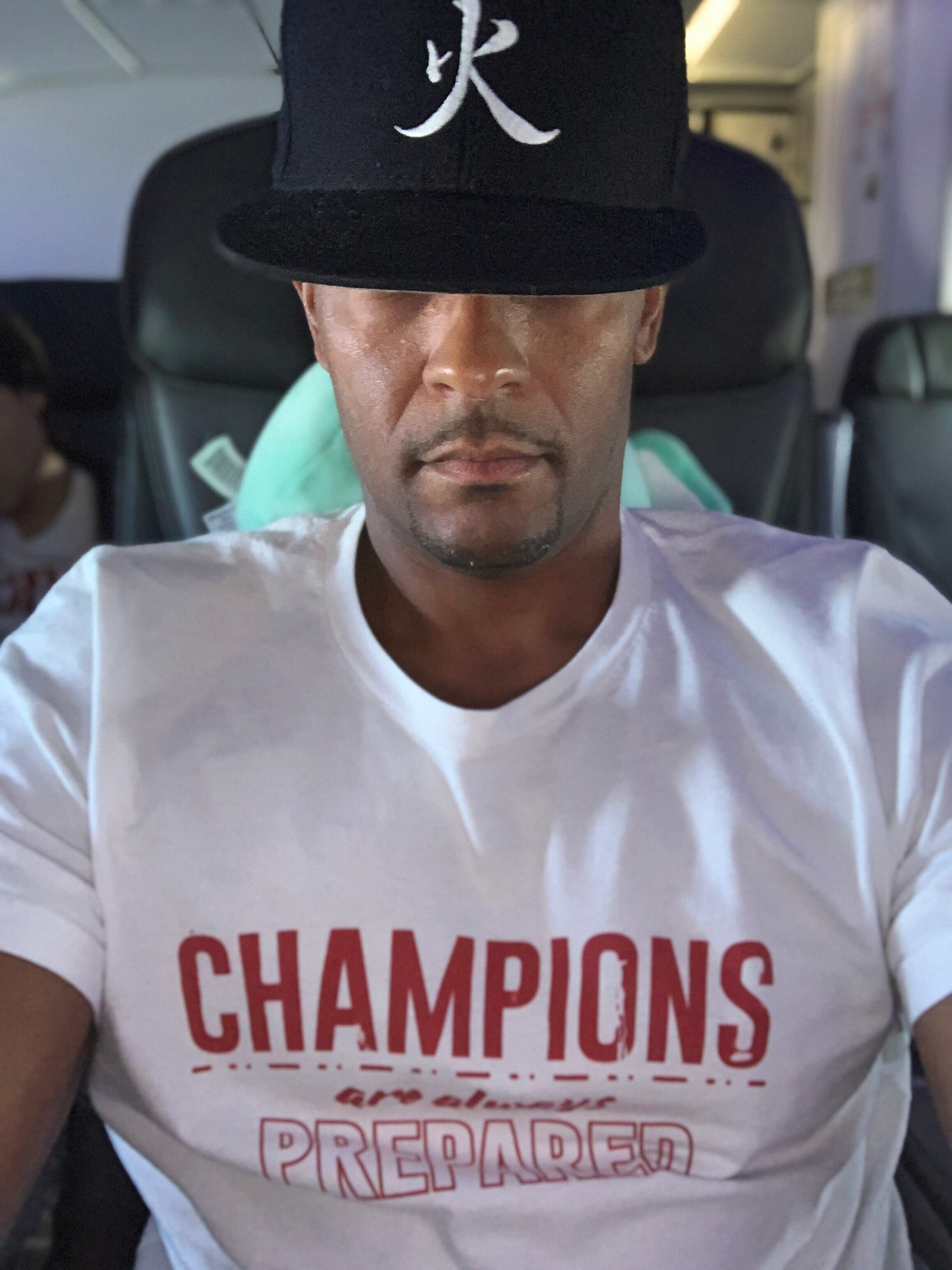 Travel ready wearing CHAMPIONS ARE ALWAYS PREPARED tee.