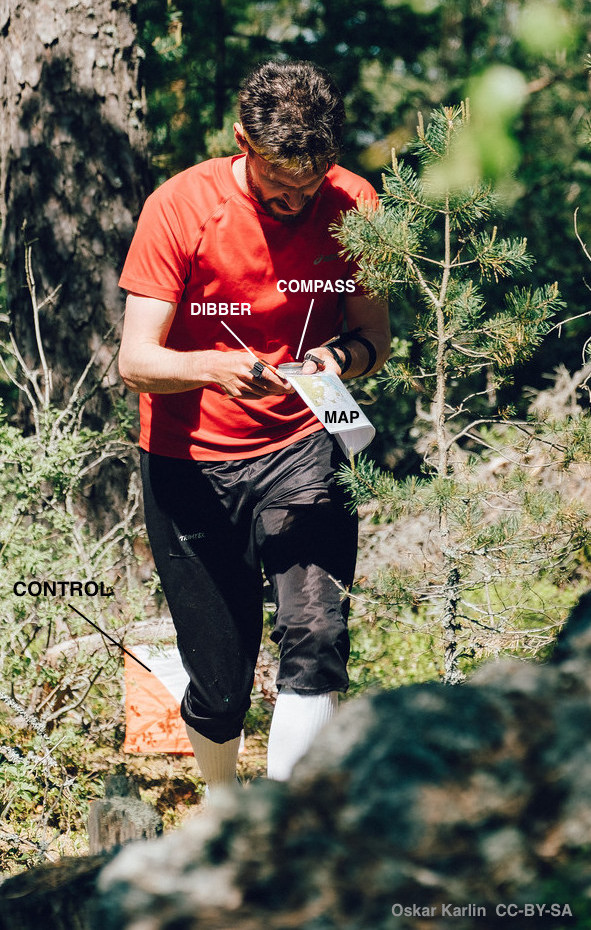 An orienteer leaving a control site.