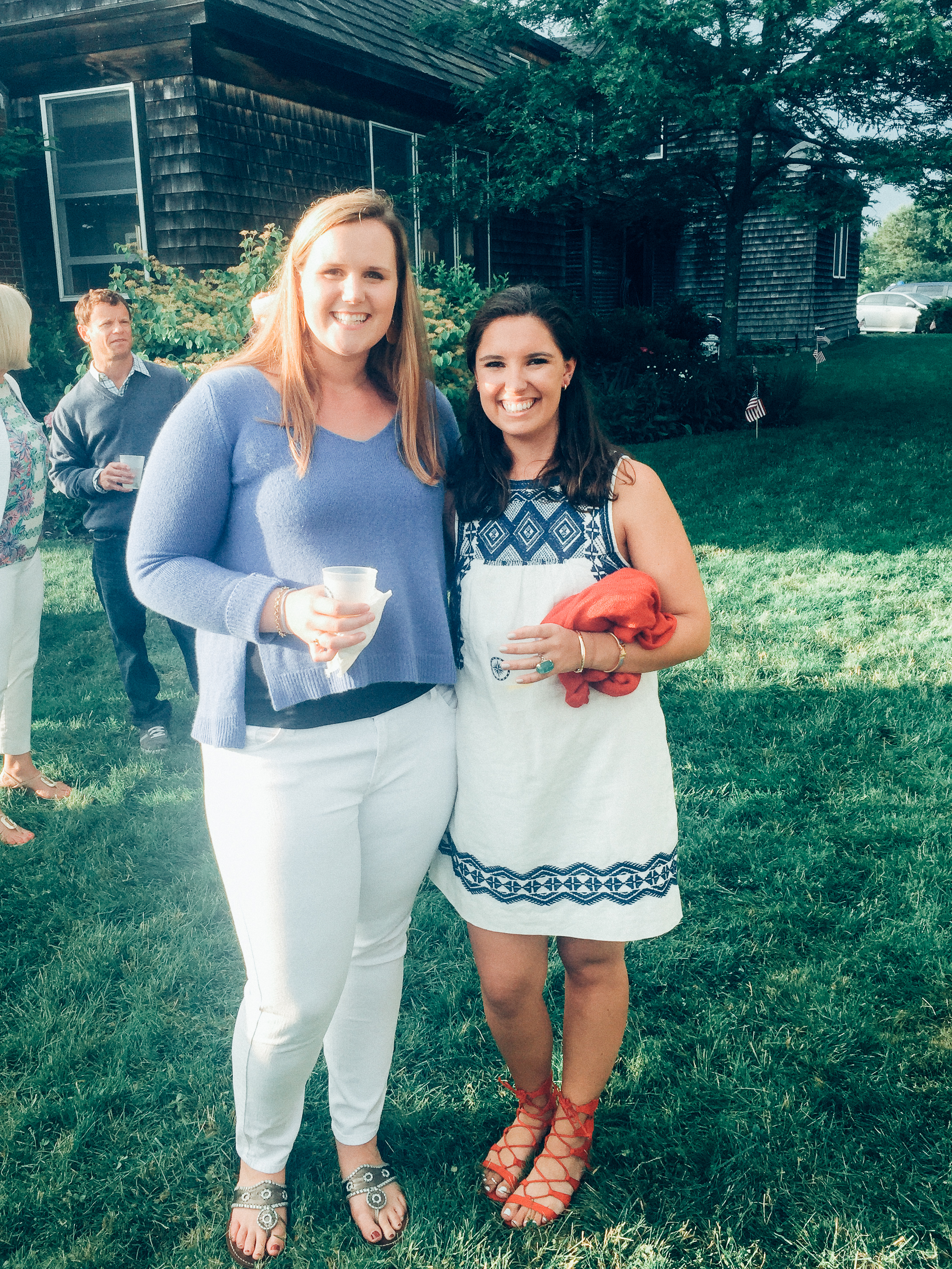 at a 4th of July party with one of my oldest friends, Izzy.   Nan= Calypso Sweater  (similar),   White Denim,   Jack Rogers.  Izzy =  Madewell Dress,   Red Sandals.