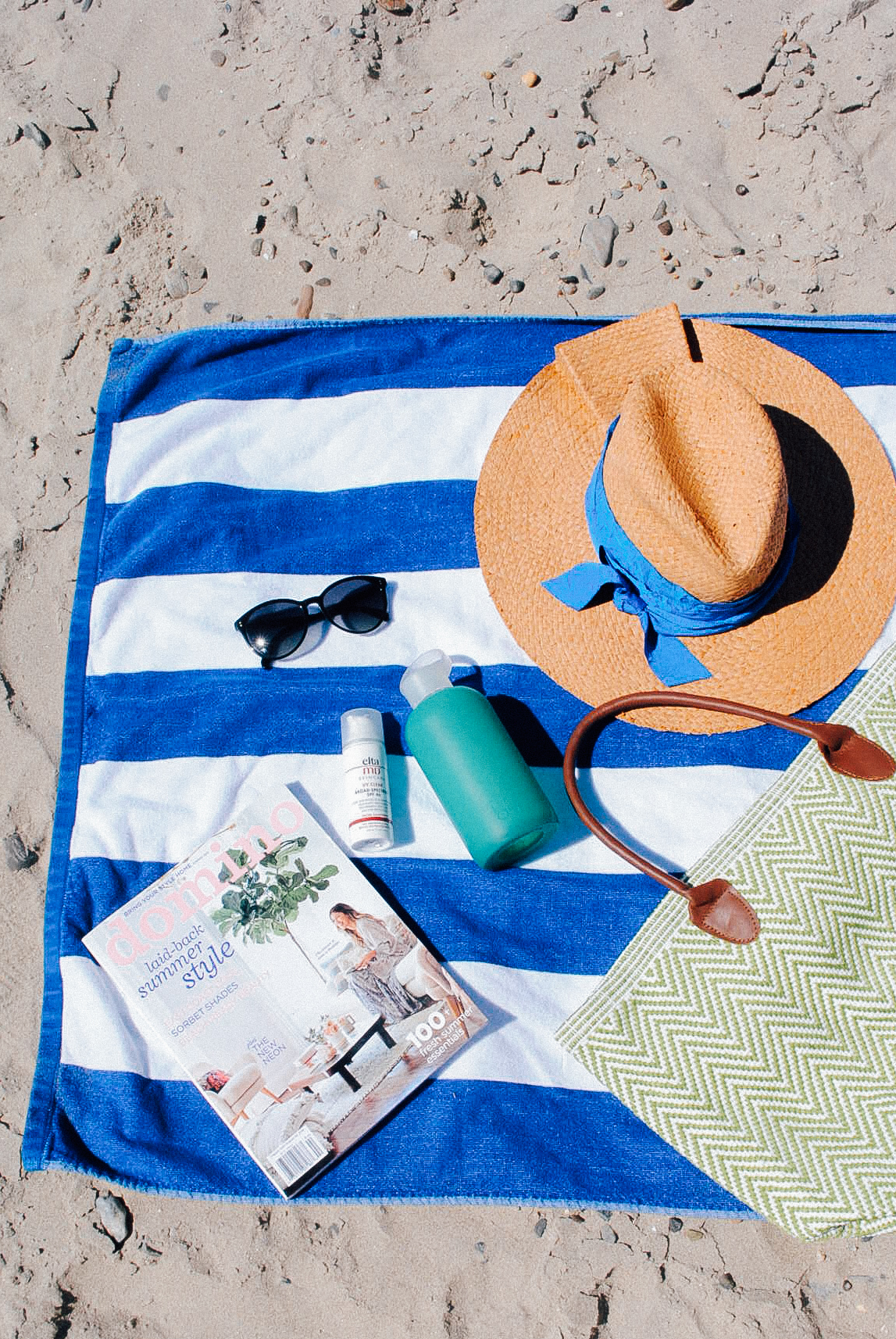Beach Bag Essentials: Elta MD sunscreen, Oliver Peoples Sugnalsses, Lola Hat, Domino Magazine, BRK Waterbottle.