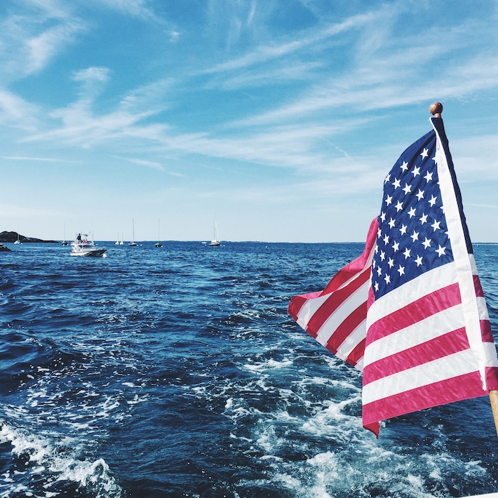 american flag and the ocean