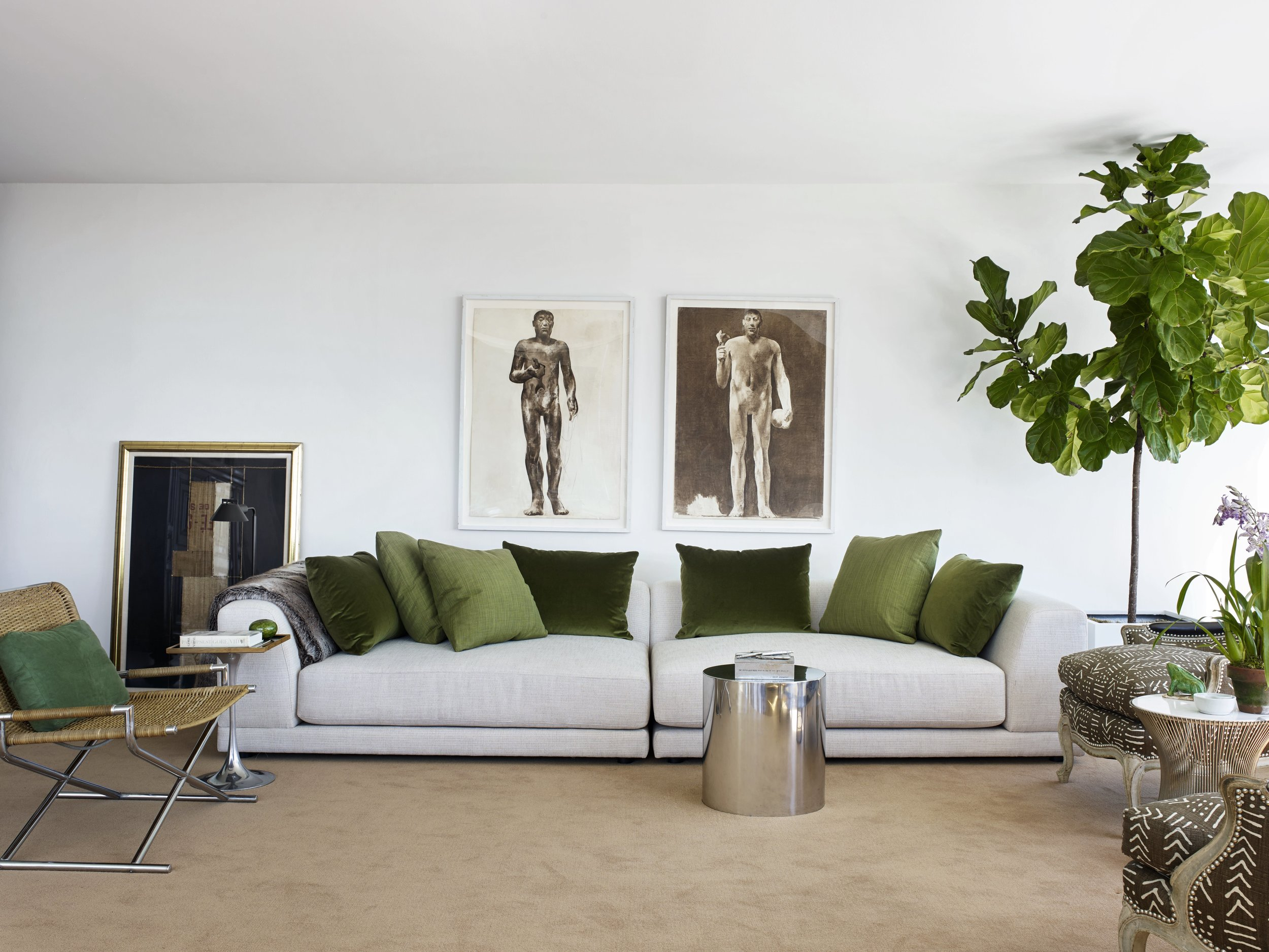 The living room in Tom's Manhattan apartment with green pillows to reinforce the green theme in the whole apartment.