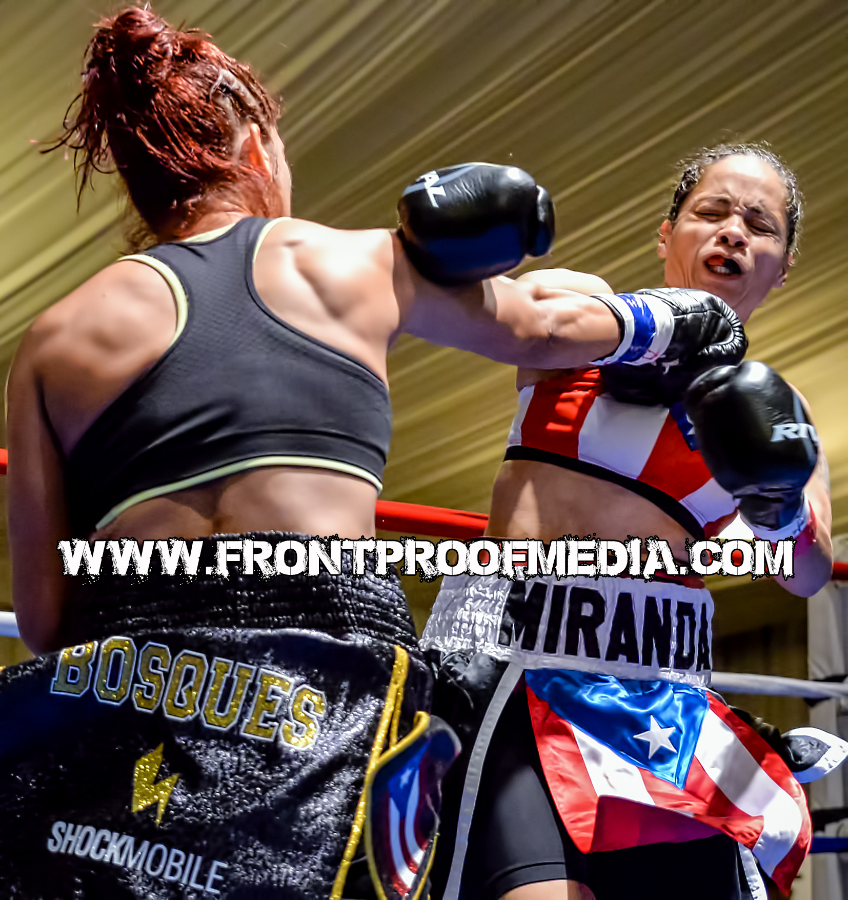 Noemi Bosques lands a punishing right hand to the chin of Marisol Miranda during their WIBA title fight on Aug 22, 2015 in St. Petersburg, FL