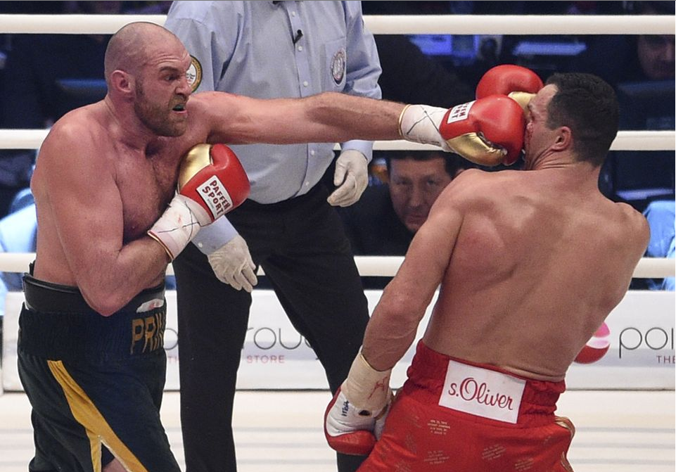 Tyson Fury lands a stiff left hand to the face of Klitschko during their Saturday night clash in Dusseldorf, Germany Photo credit: (AP Photo/Sebastian Konopka)