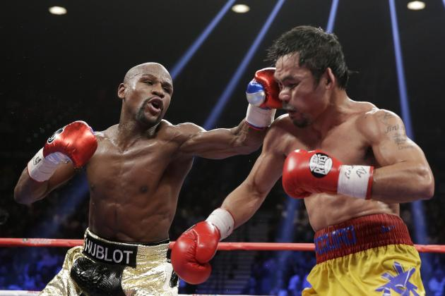 Mayweather lands to the face of Pacquiao    photo credit: Isaac Brekken/Associated Press